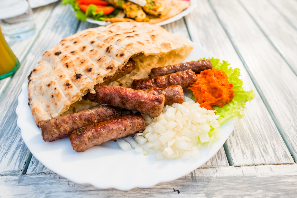Cevapi (rolled veal sausages with pita bread and a red bell pepper spread)