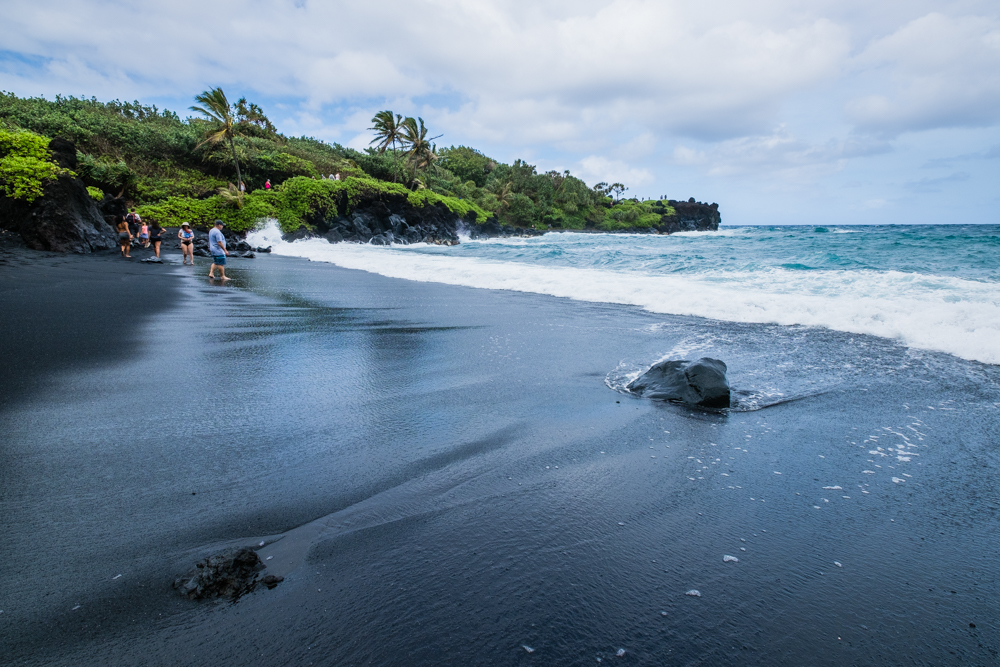 Papilla Beach- rated one of the top beaches in America. The black sand provides a sharp contrast against the luscious greenery and aquamarine waters. Be careful, though. The tide can rise fairly quickly. So, it's not one where you want to lounge around and sunbathe.