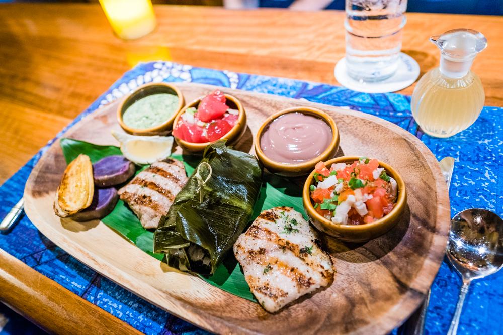 Traditional Hawaiian -Mahimahi and Ahi with Big Island wild boar slow-cooked in a ti leaf, traditional Hawaiian sides of octopus luau and Ahi poke