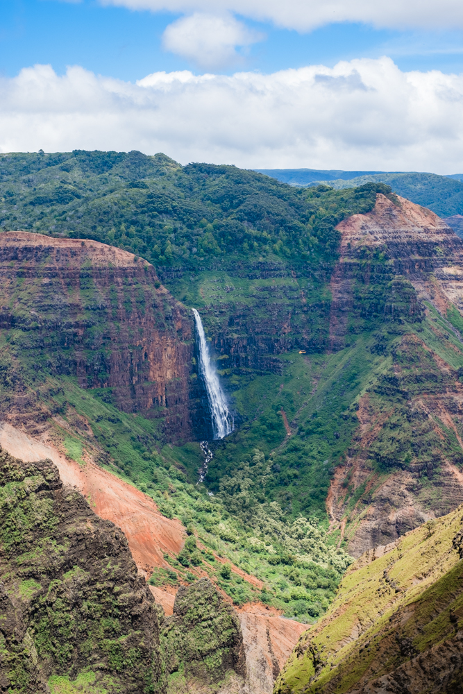 You can spot this view by stopping at one of the lookout points along the road. Or, by taking a helicopter (some will even drop you off near the waterfall so you can walk around).