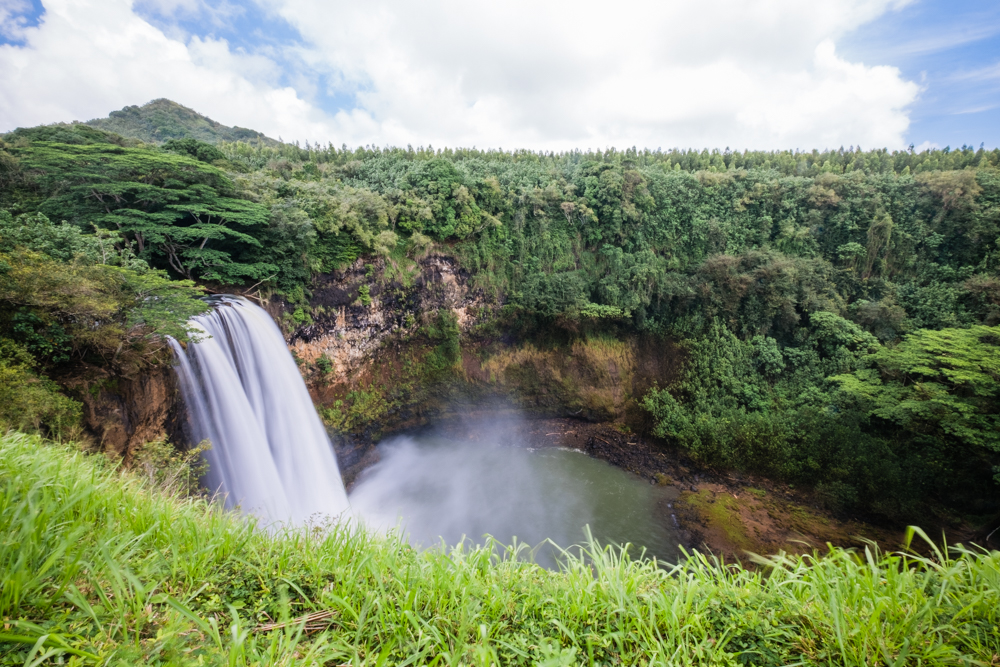Wailua Falls is one that is easily accessible by car and has a nearby parking lot, no hiking necessary. It is located near Lihu'e off of Highway 56.