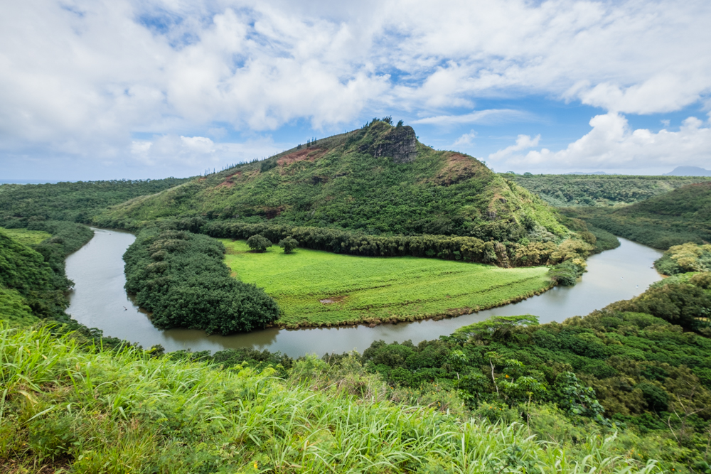 If you walk right across the street from Opaeka'a Falls, you'll stumble upon this fantastic view of the mountain ridges of Maunakapu and the Wailua River. If you arrive before dawn, you may come across a beautiful sunrise.