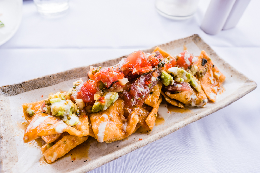 """Adam's Poke Nachos"": ahi poke, local tomato, avocado, tobiko, inamona, wasabi cream, mirin-yake, crispy wonton chips"