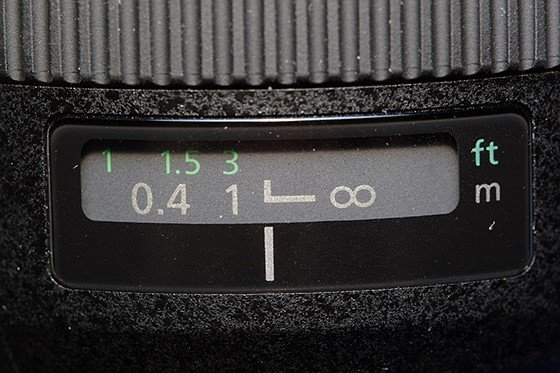 "The symbol for manual focus on a standard Canon lens. The range within infinity focus falls varies from lens to lens and there is a degree of trial and error before finding what I call the ""sweet spot"". You can find infinity focus during the day more easily and then leave your lens set to Manual Focus to use at night. I still suggest crucial double checking at night in order to make sure nothing has changed since daytime. (Photo: DPReview)"