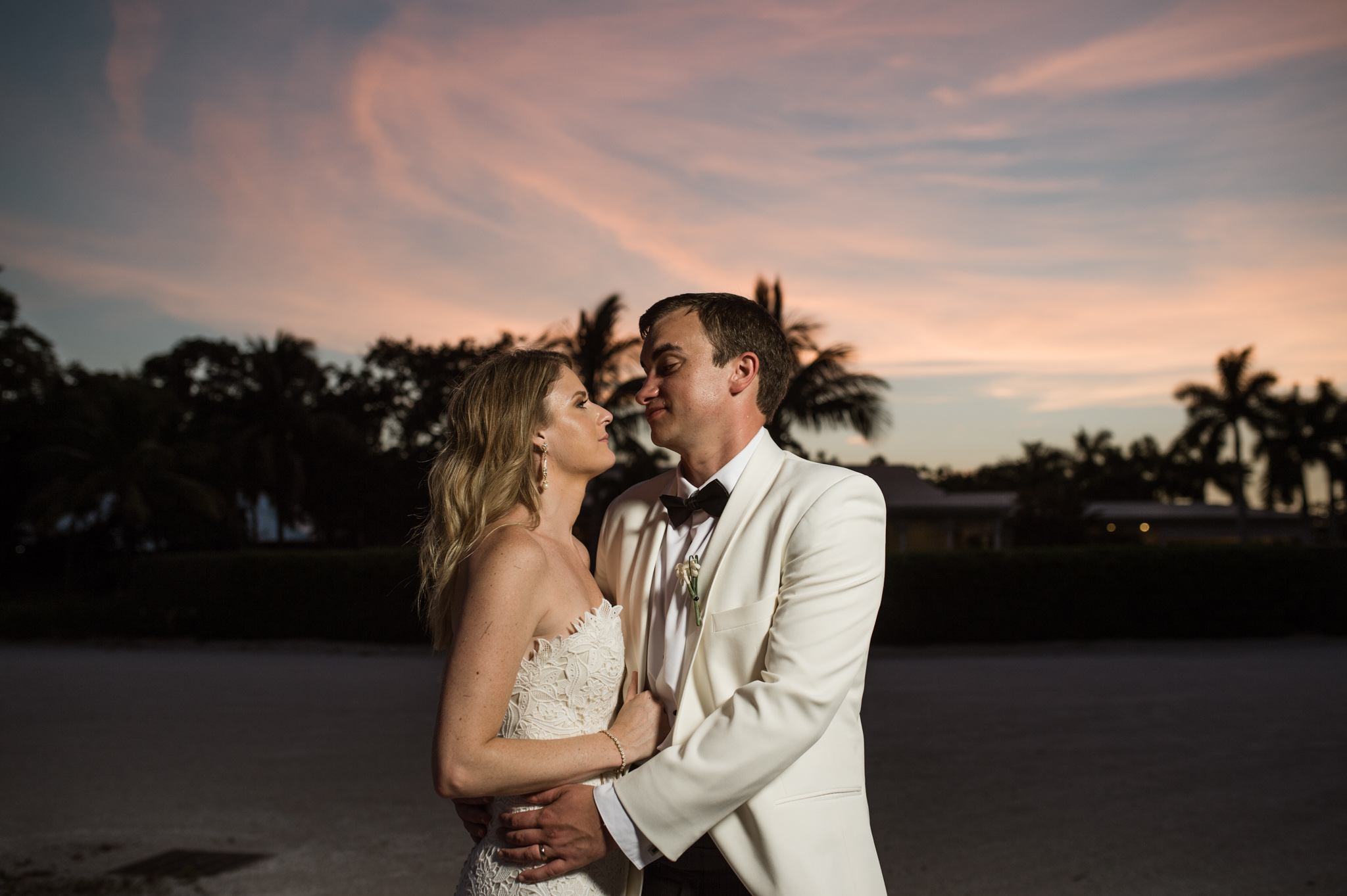 Dramatic Sunset Portrait of Bride and Groom at the Longboat Key Club in Sarasota, FL