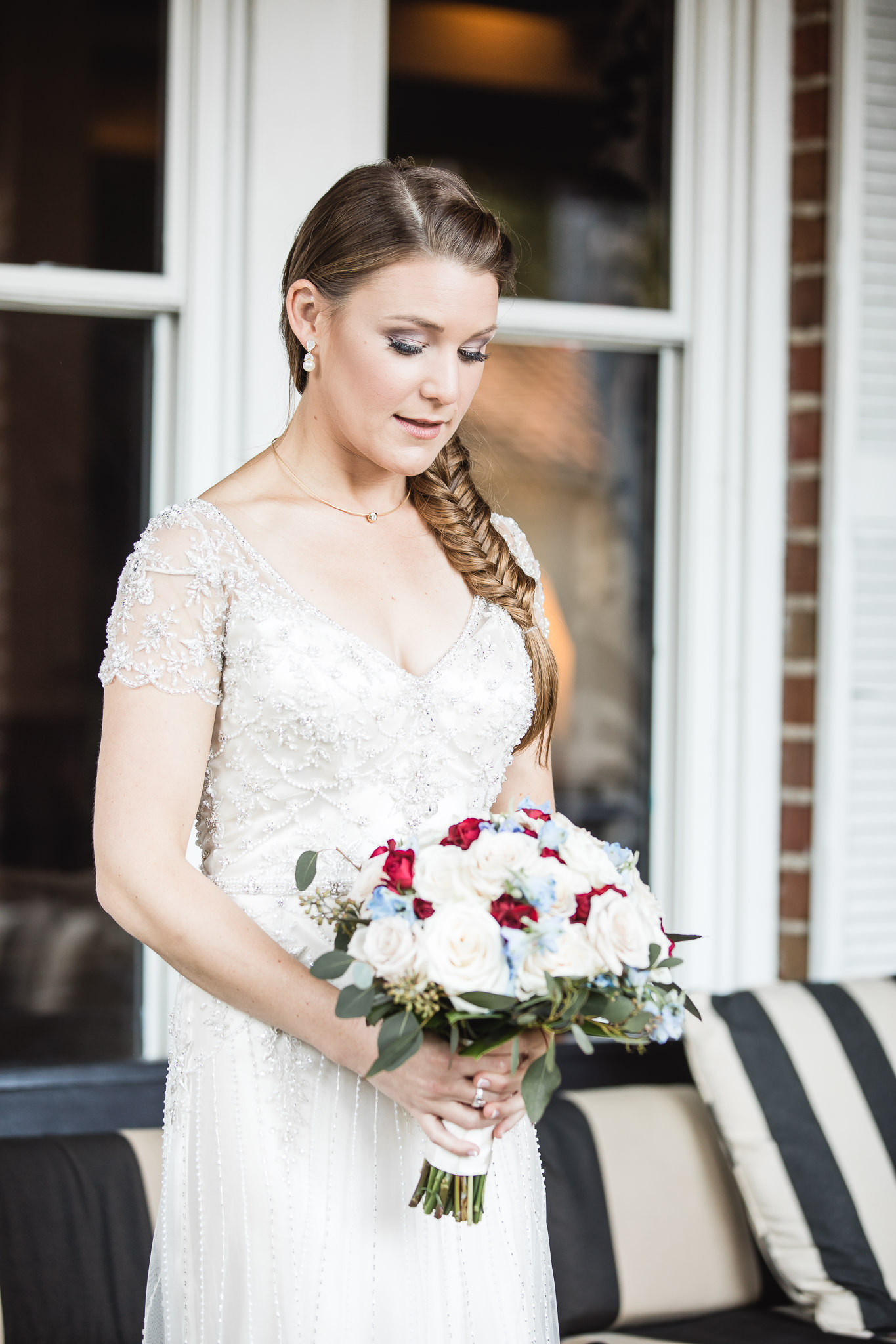 Photograph of bride in thought at The Hollander Hotel in St. Petersburg, Florida