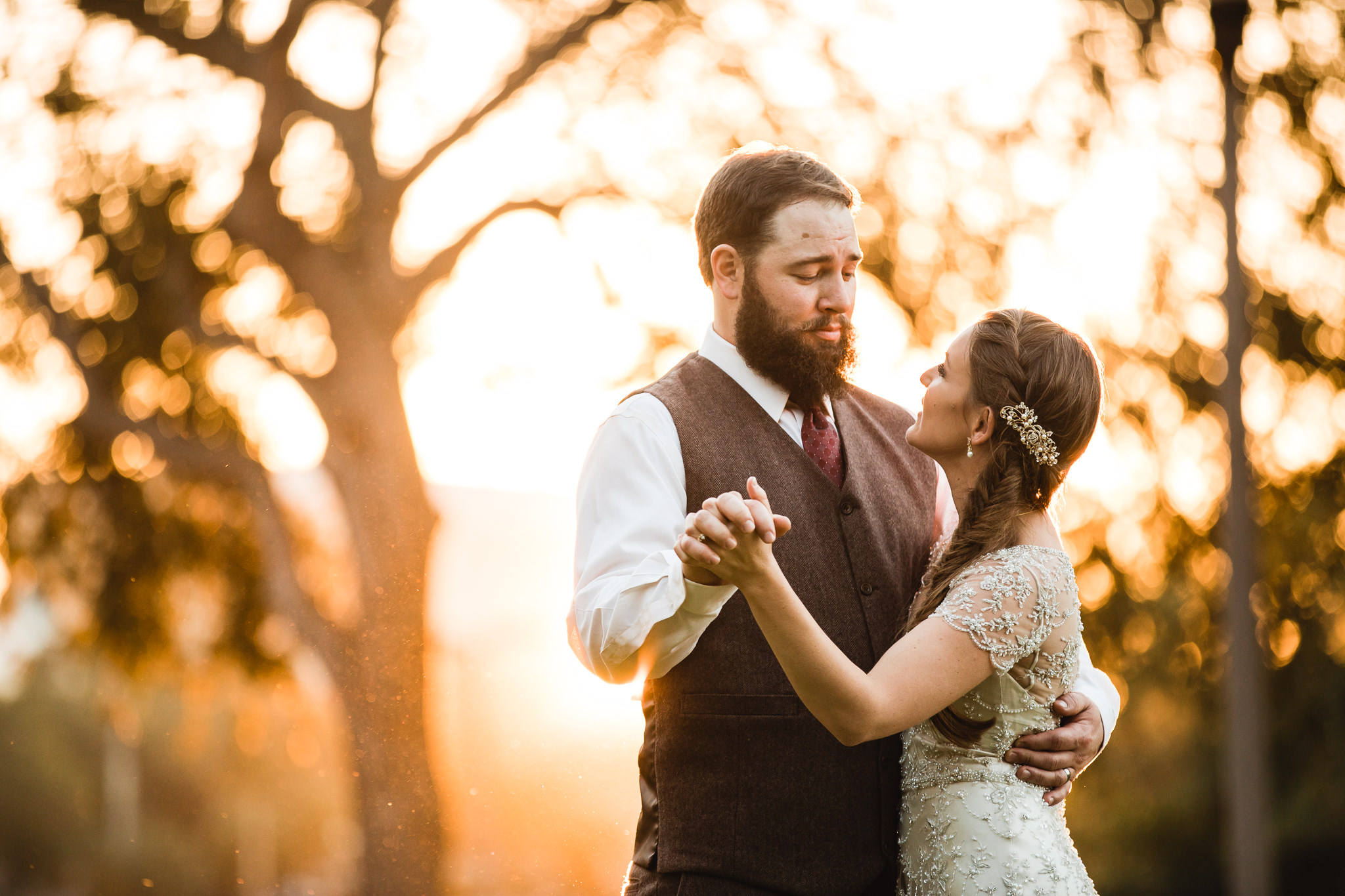Sunset wedding photograph of bride and groom at Mirror Lake Park in St. Petersburg, Florida