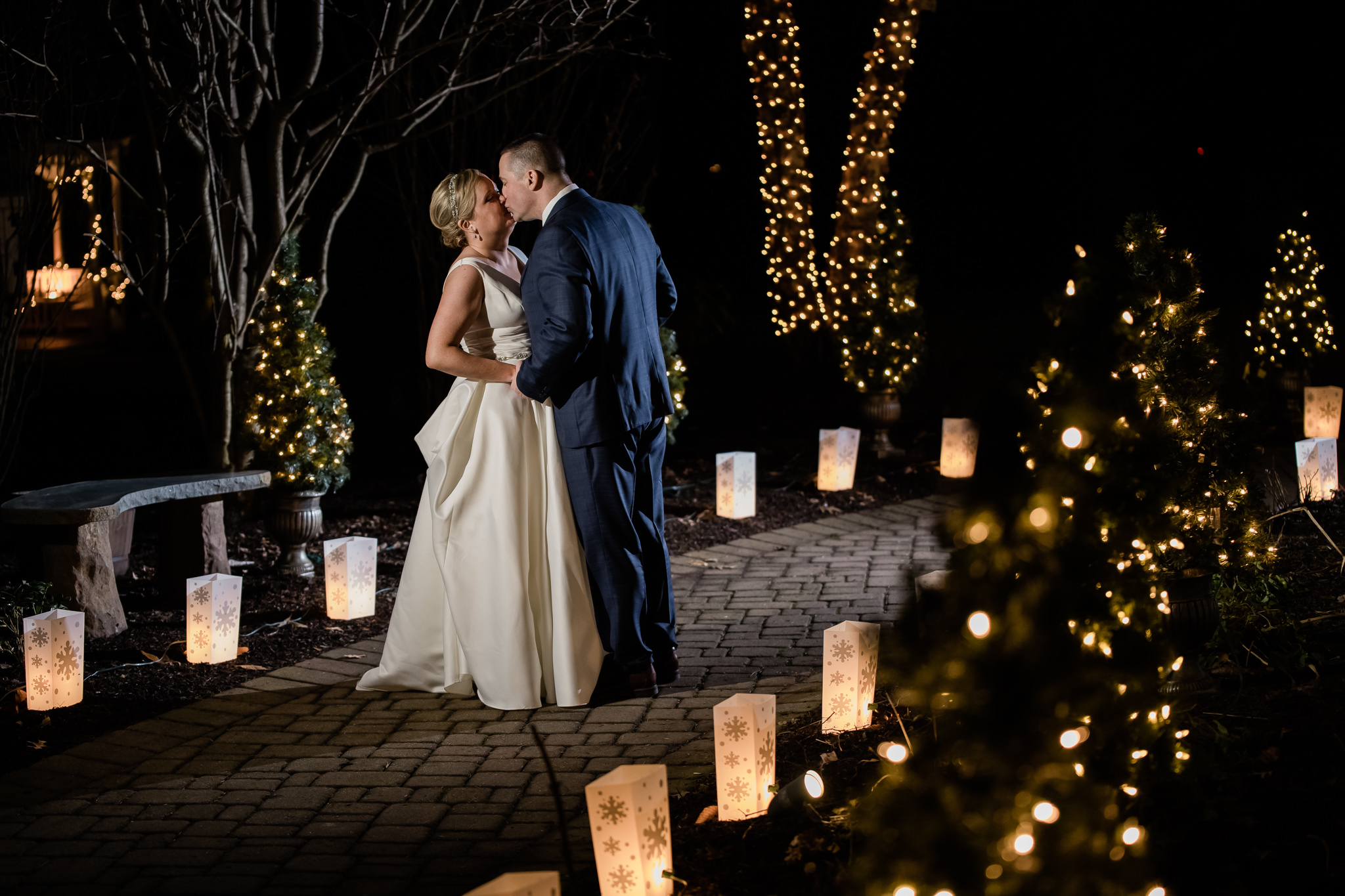 Bride and groom during their winter wedding at the grain house in basking ridge new jersey with blue and orange Christmas themed lights