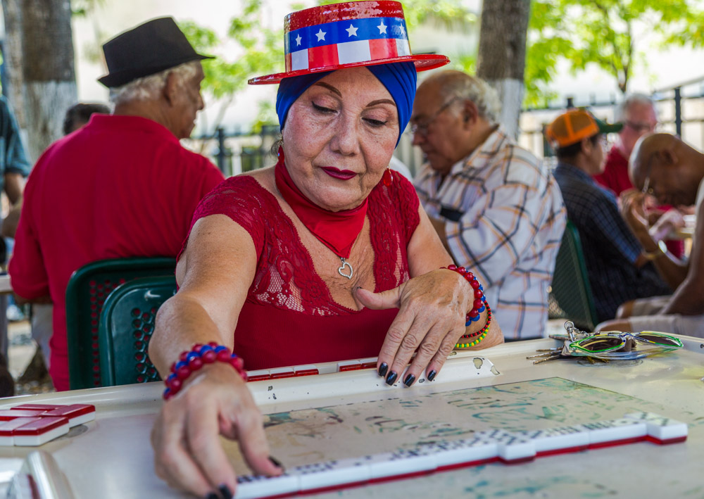 Rina, Cuban American; likes to dress up and play dominoes.