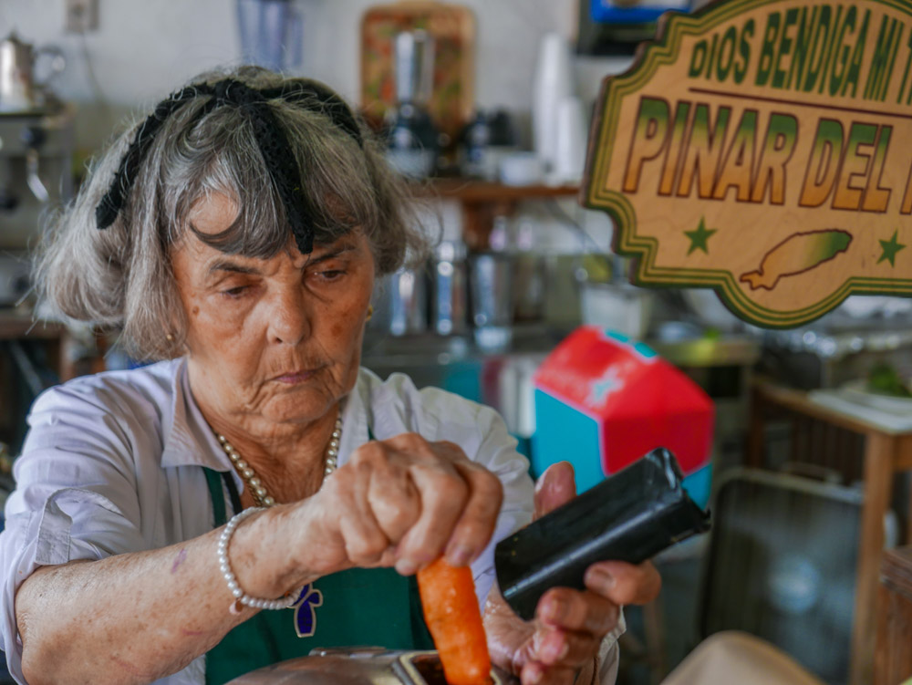 """Guillermina, Cuban American; has worked for over 50 years at """"Los Pinareños"""" fruit market."""