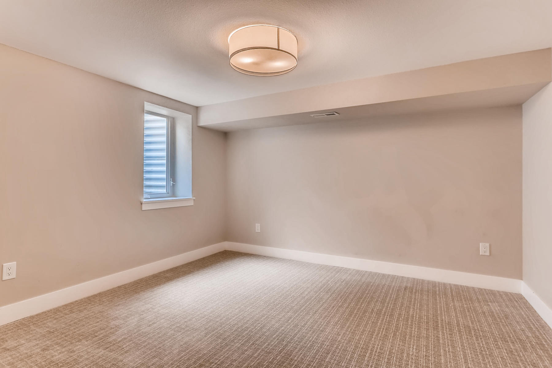 1051 Newport Street Denver CO-024-2-Lower Level Bedroom-MLS_Size.jpg