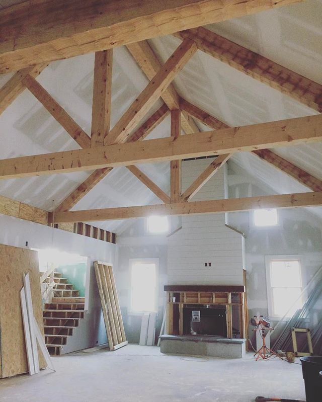 These hand hewn timber trusses are boldly adding detail to the high ceiling. Paint and stain are only going to sweeten the deal.  #customhome #homebuilder #builder #generalcontractor #timbers #trusses #handhewn #greatroom #underconstruction #shiplap #fireplace #marietta #kennesaw #cobbcounty #georgia
