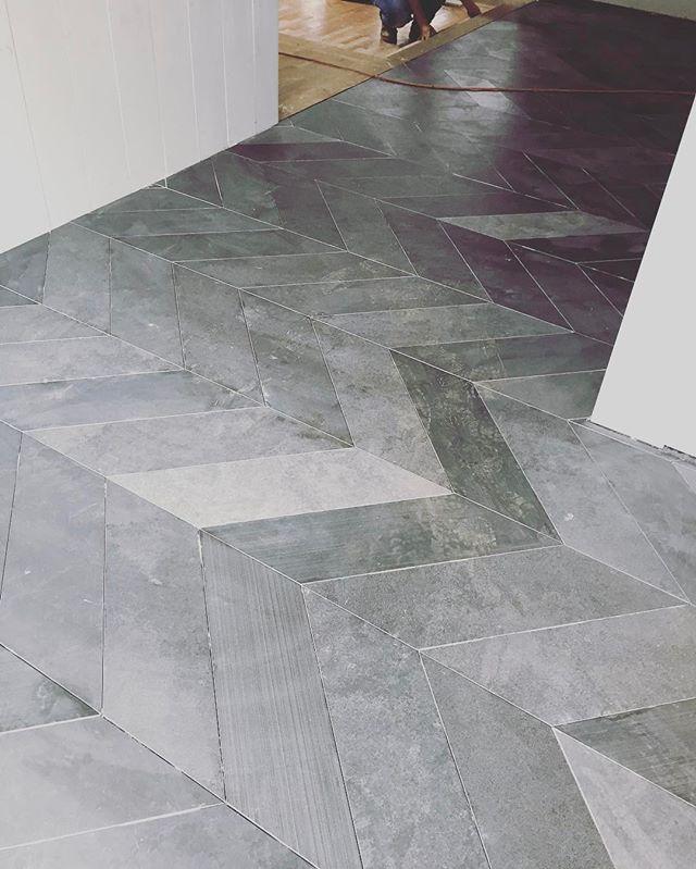 Entry tile going down.  #customhome #homebuilder #builder #generalcontractor #tile #chevron #shiplap #entry #marietta #cobbcounty #georgia #underconstruction #remodel