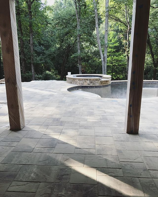 Belgard Rustic Slab pavers are making for a really nice pool deck. Almost finished...