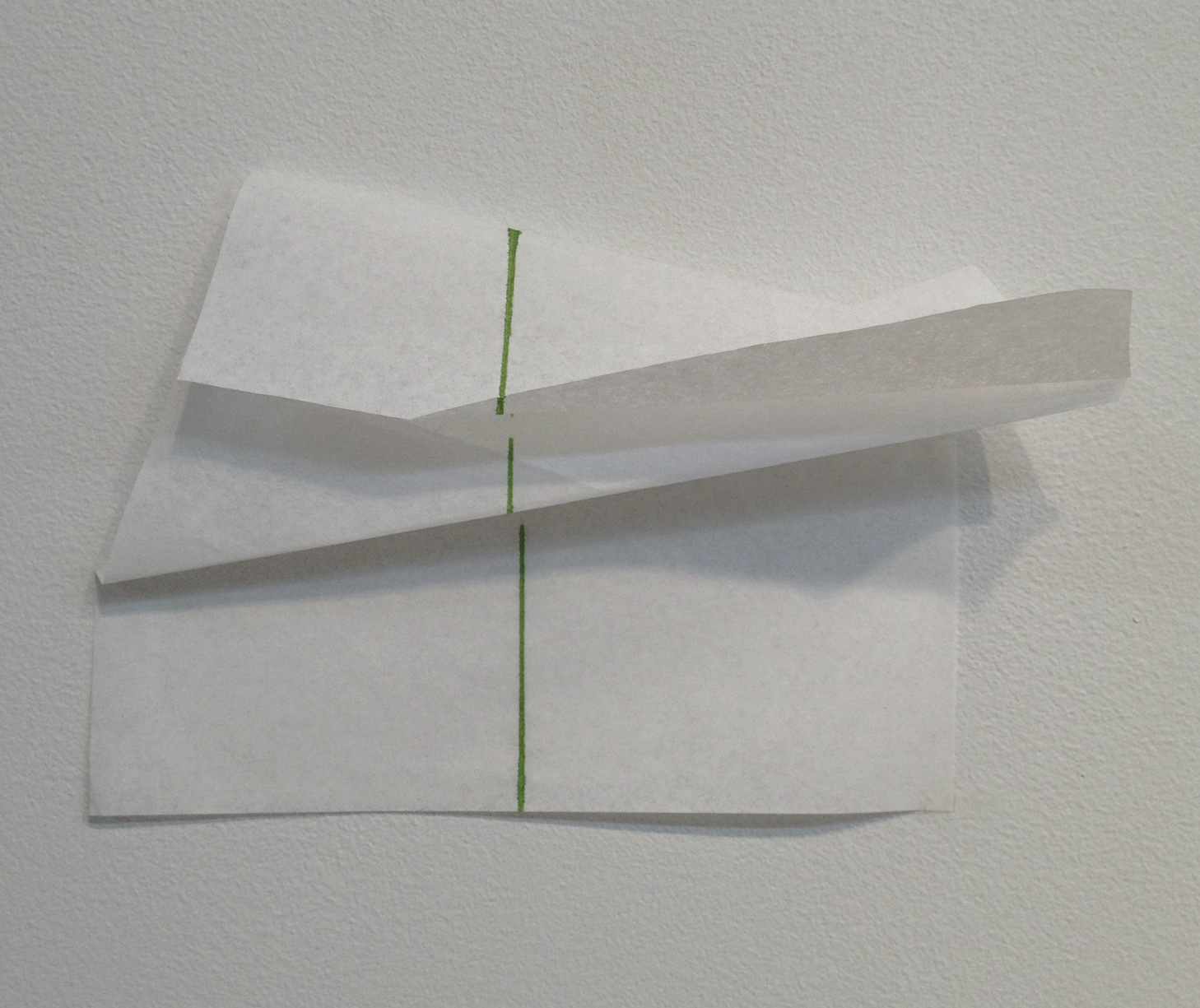 The effect of a fold on a line, green.