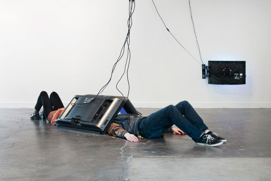 """Eva and Franco Mattes  """"Befnoed,"""" 2014  Videos (various lengths), flatscreen, custom-made wall mount bracket, cables  Exhibition view, Feldman Gallery at PNCA, Portland OR"""