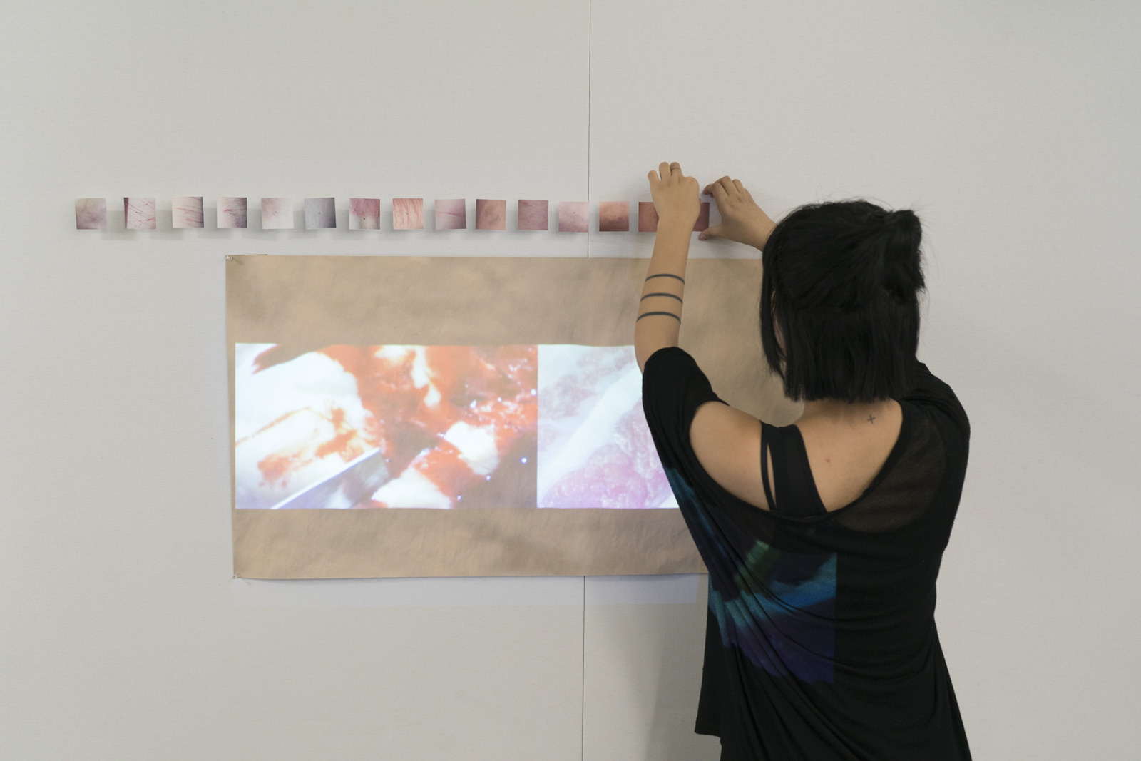 Returning student Di Wu setting up her mixed media works.