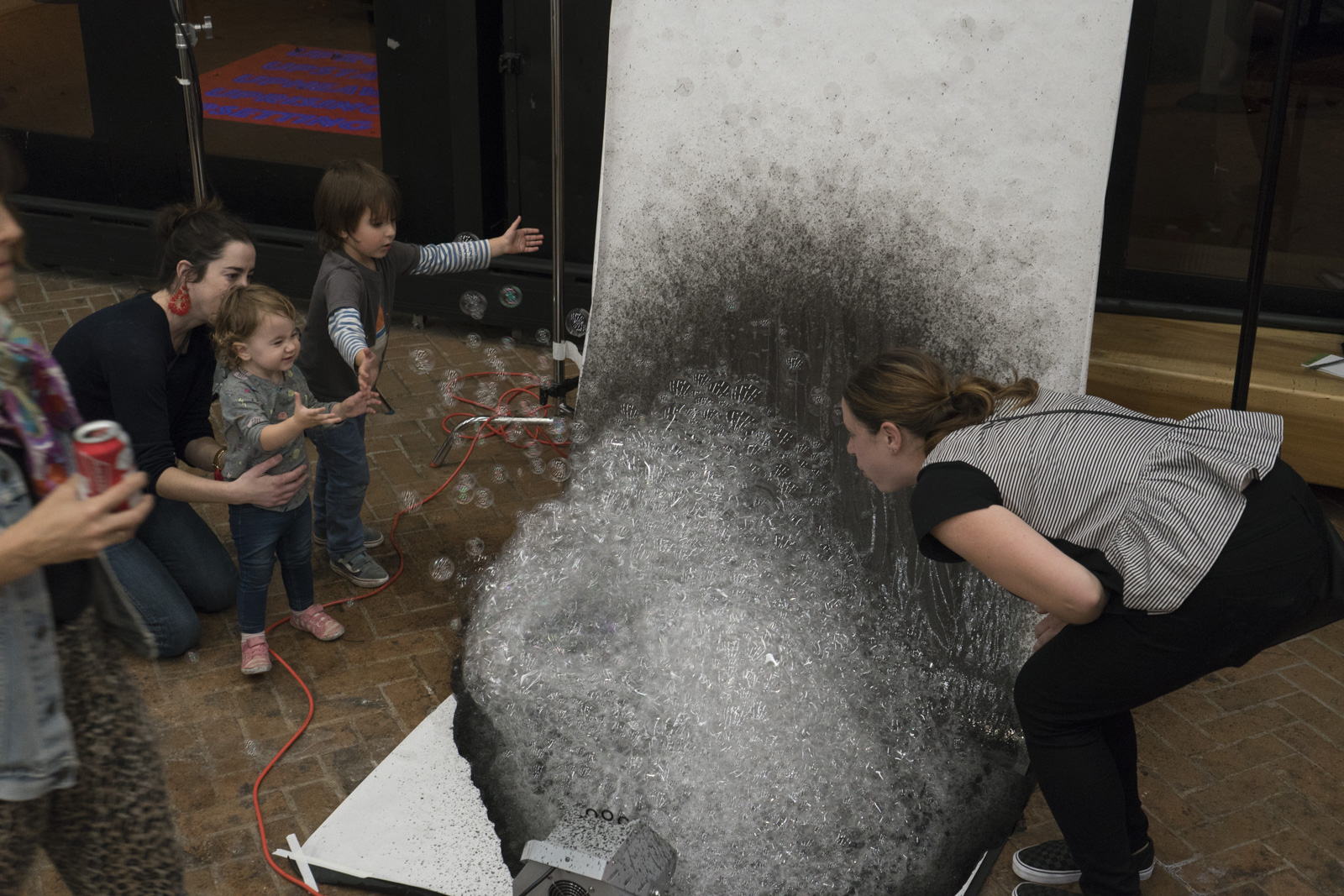Guests playing with Jing Lin's bubble machine.