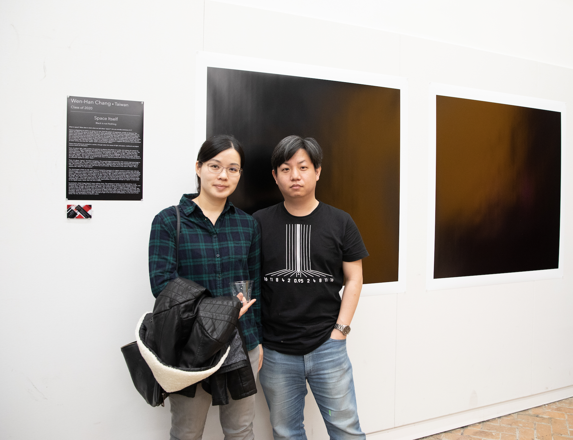 Wen Han Chang  (class of 2020) and guest beside his work.