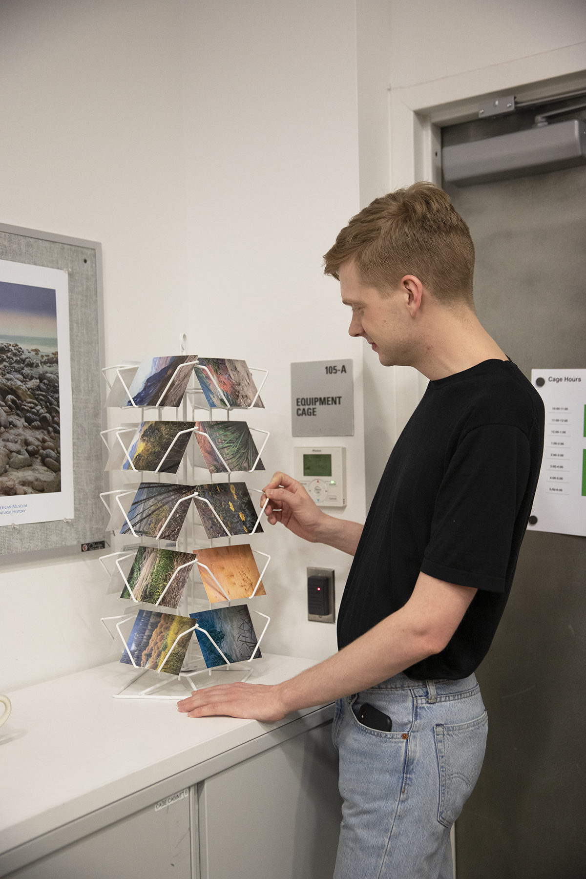 A Salon guest peruses Hannah La Follette Ryan's photograph postcards