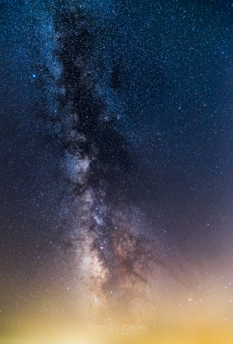 The Milky Way and light pollution from distant towns over Cape Cod Bay. (© Kevin D. Jordan Photography)
