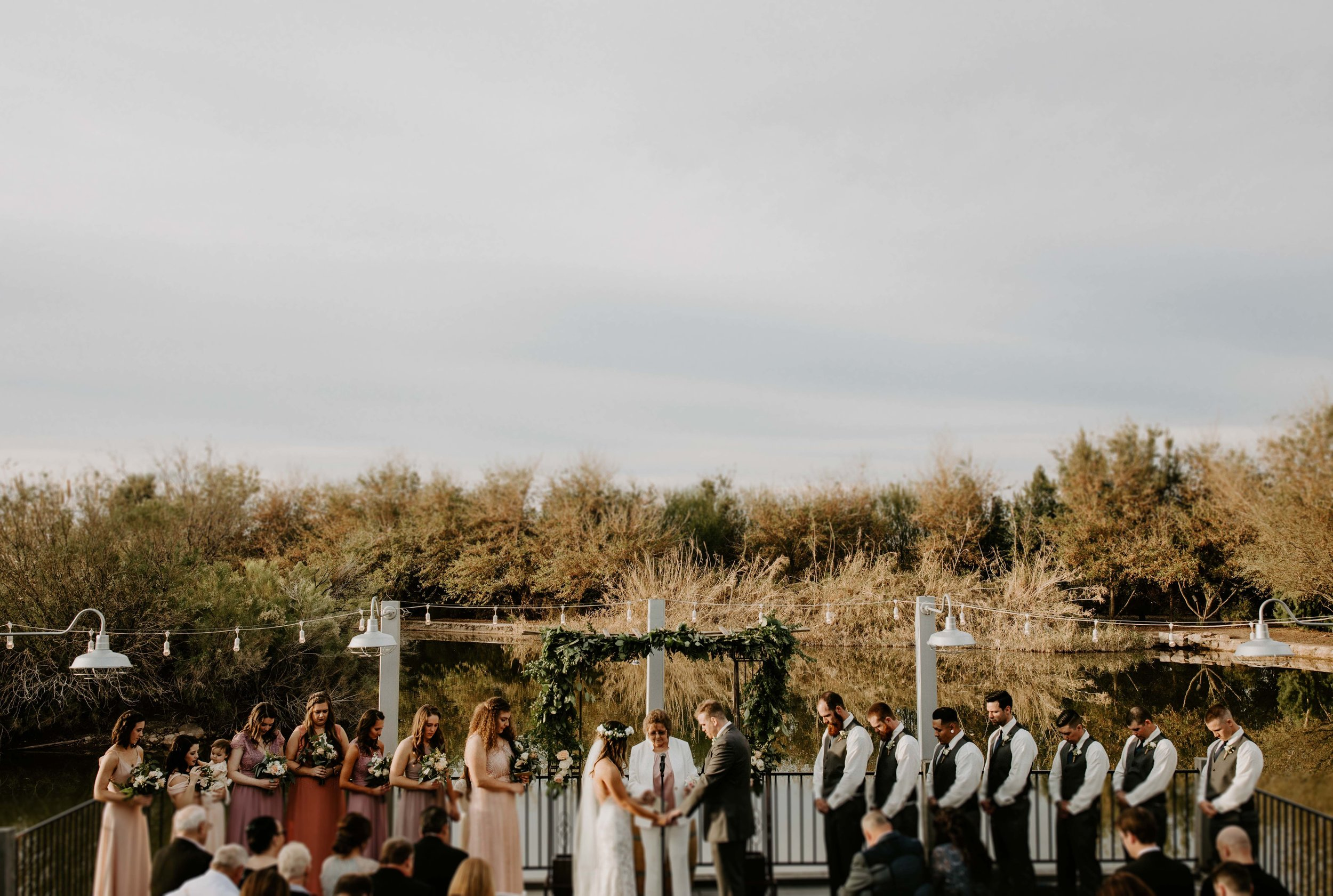 Boat dock on the lake ceremony space at Windmill Winery wedding venue in Arizona