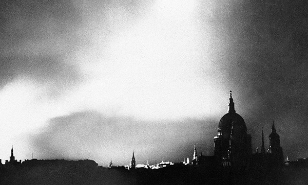 08-Raging-fires-silhouette-St-Pauls-Cathedral-after-a-lone-German-bomber-dropped-incendiary-bombs-Sep-1-1940-01.jpg