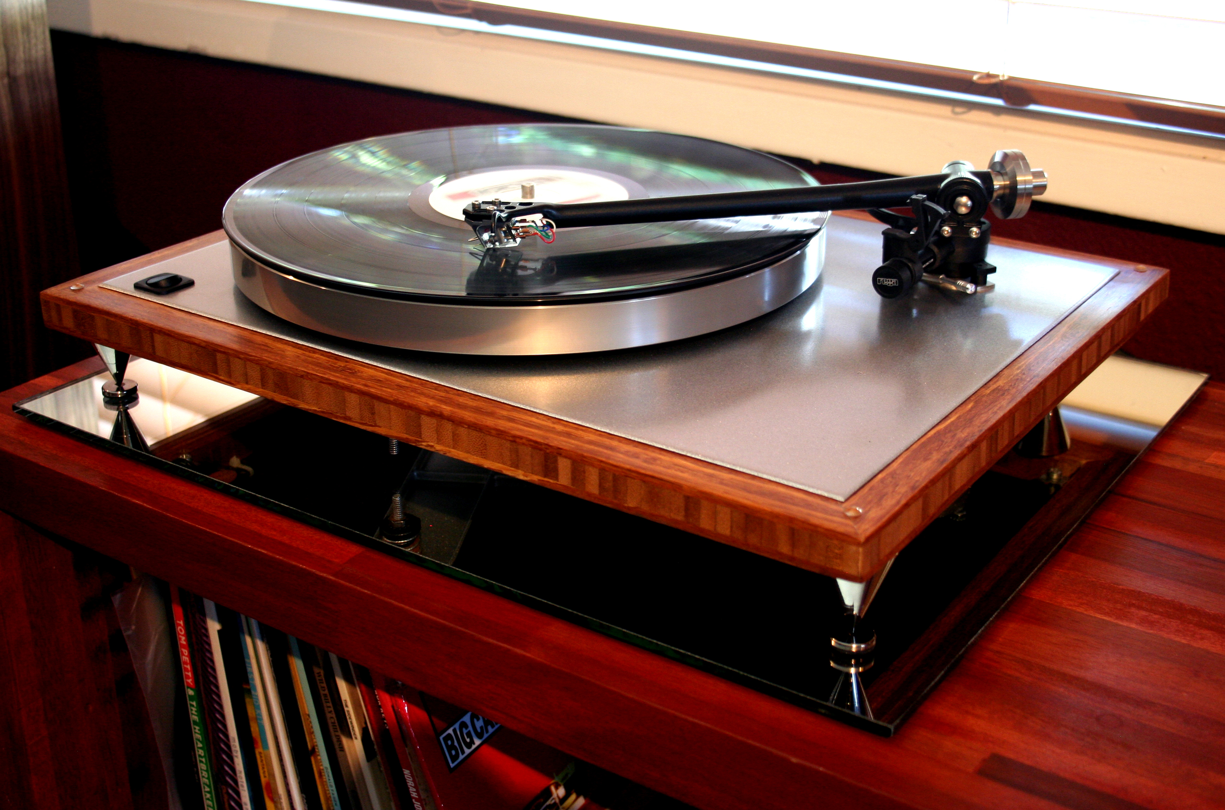The Naked Bamboo   Acoustic Research T-bar, platter, sub-platter, sparkle silver top plate, Rega 303 tonearm, Hurst 300 motor, real bamboo base, rocker on/off switch, 2.5 inch metal spikes, custom dust-cover. $1299 w/out cartridge.