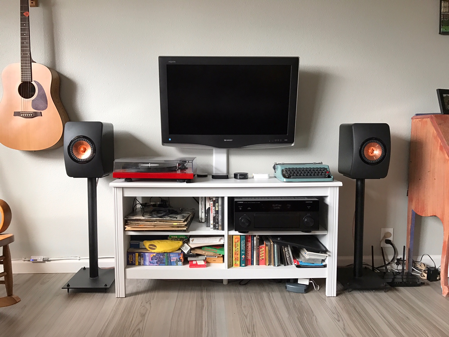 Kailin System:  Yamaha AV receiver, ProJect Debut Carbon turntable/Ortofon Red, KEF LS50 speakers, GHA custom speaker stands.