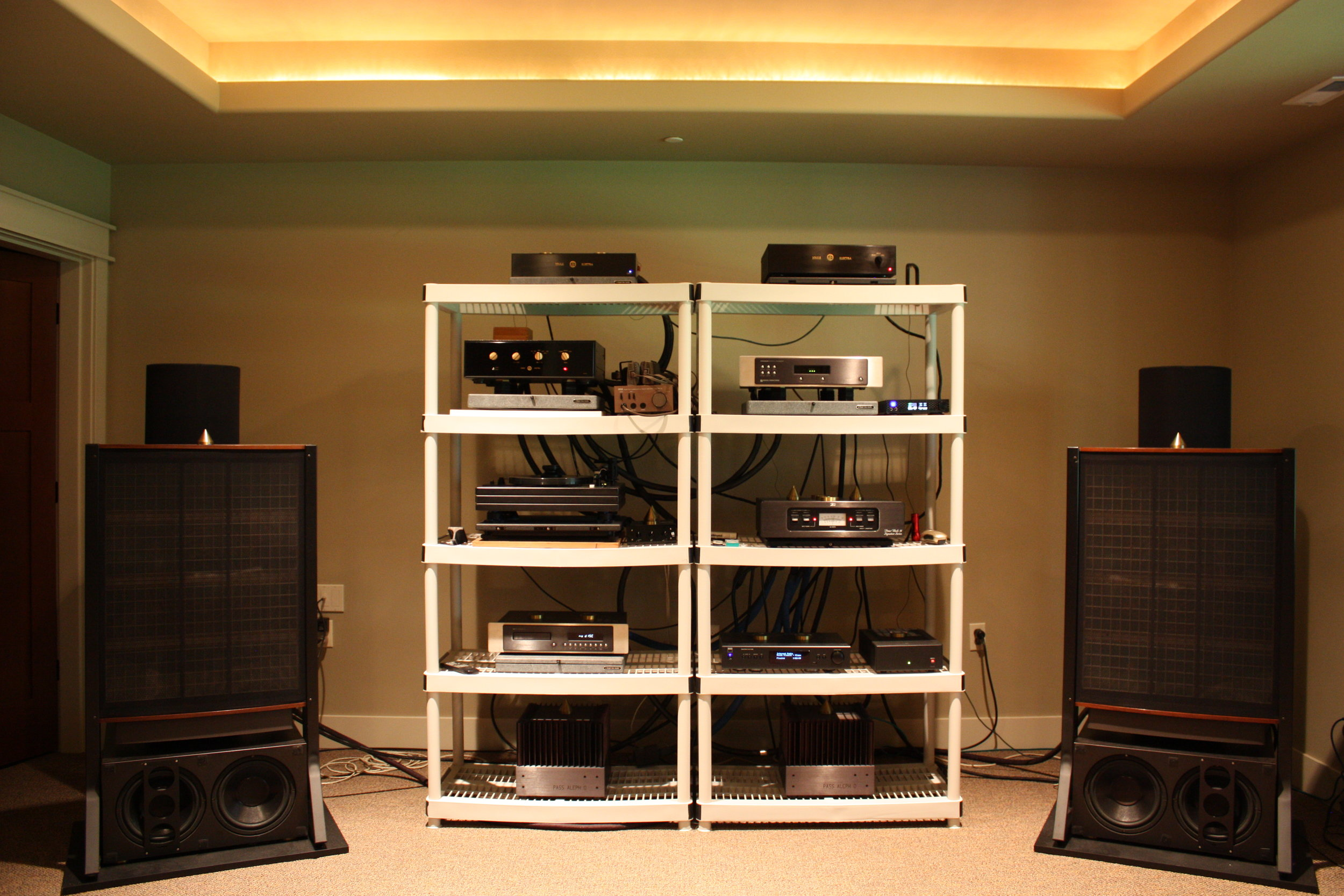 Dr. Jay's Music Room System : Joule Electra LA-150 MK-I Preamp, Joule Electra OPS-1 MK-III Phono Line Stage, Joule Electra Phono Stage Power Supply, Sonic Frontiers, SFT1 Transport with I2S, Sonic Frontiers Processor 3 DAC, Sonic Frontiers Power Supply, Well-Tempered Turntable with Transparent Audio upgrades, Van den Hul Frog phono cartridge with Hovland Music Groove cartridge cable, Nelson Pass Aleph 0 monoblock amps x 2, Mytek Brooklyn DAC, NAD C446 Digital Media Tuner, Stax Signature Lamba Pro Headphones, Quad ESL-63 Electrostatic speakers on Arcici stands, Electrostatic Bass Traps, Entec L2-F20 Subwoofers, Tice Signature III Power Block conditioner, Cables: Aural Symphonics interconnects and power cords, 100 Amp dedicated service panel. HOLY COW.