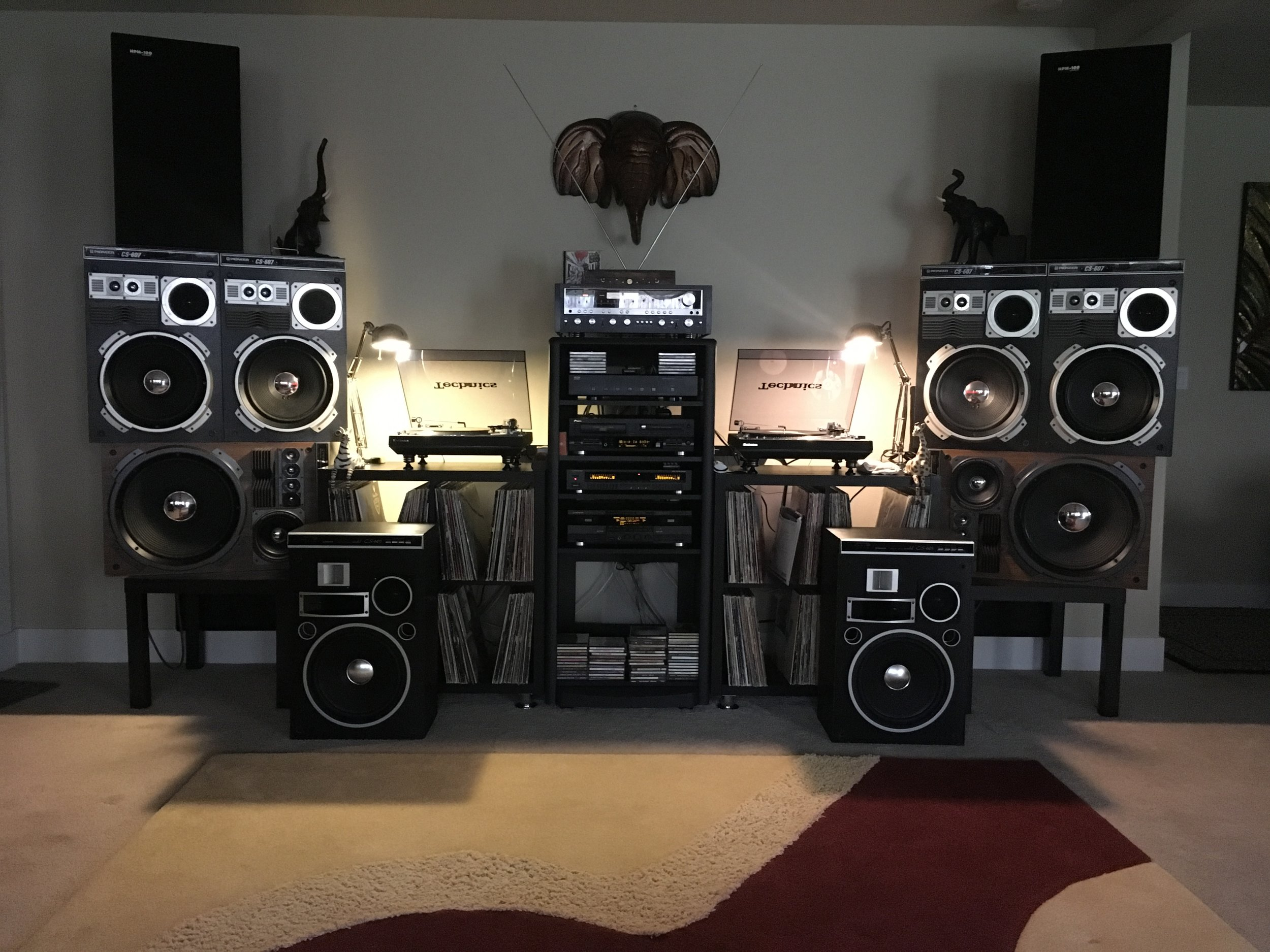 M-Perkins System! Pioneer SX 5580 Receiver Black Edition, Harman Kardon Bluetooth, Adcom GFS 6 Speaker Selector, Pioneer PDR W739 CDR RW Player, Pioneer GR - 777 Graphic Equalizer, Pioneer CT - W900R Duel Cassette Player, 1set Of Pioneer HPM 100 Speakers, 2 Sets Pioneer CS- 607 Speakers, 1 Set Pioneer CS-907A Speakers, 1 Set Pioneer CS-603 Speakers (Floor), 2 Technics SL 1300 Turntables. That is sweet. Hashtag: Elephants.