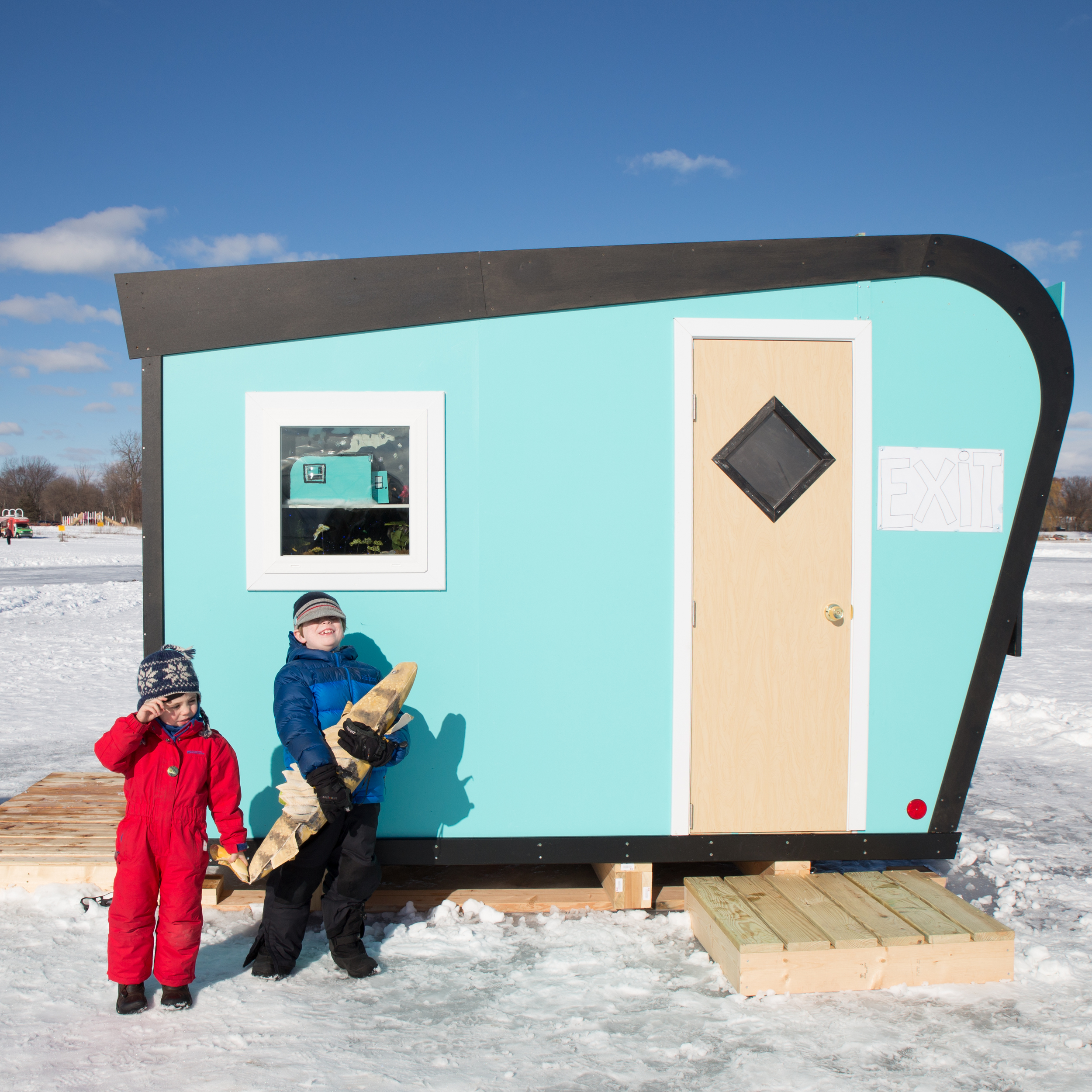 """The artists of the vintage ice fishing Catch Your Limit shanty encourage you to take a photo with a """"fish"""" in front of their shanty - like the olden days!"""