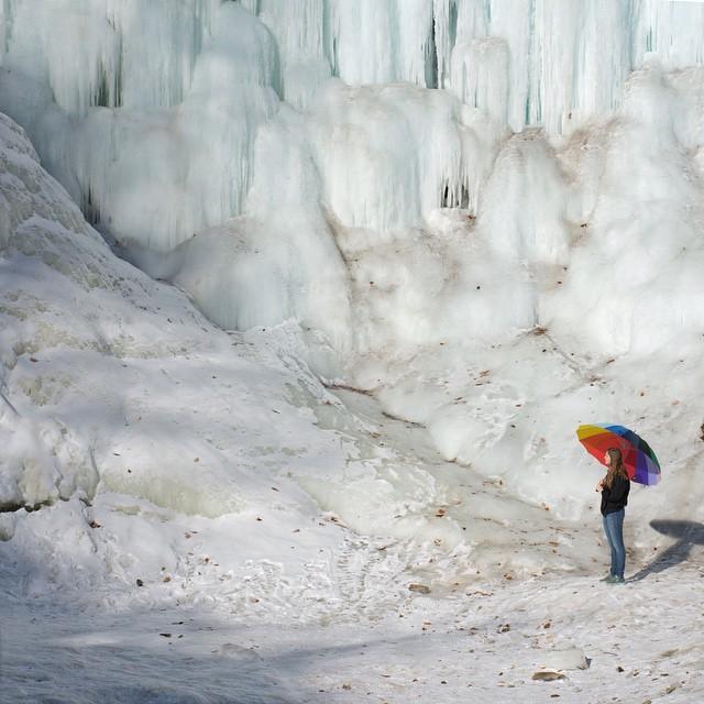 Ice Wall- Eliana and the 'brella by the frozen Minnehaha Falls