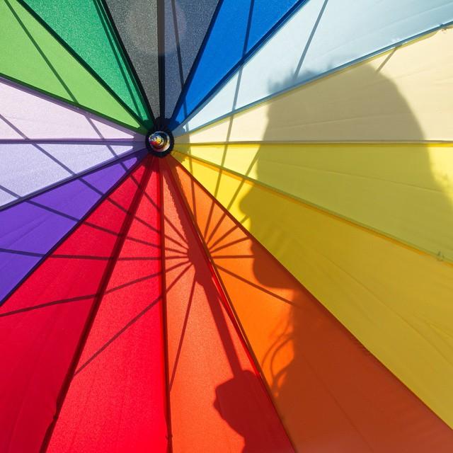 Color Play- shadow of daughter Eliana through the umbrella