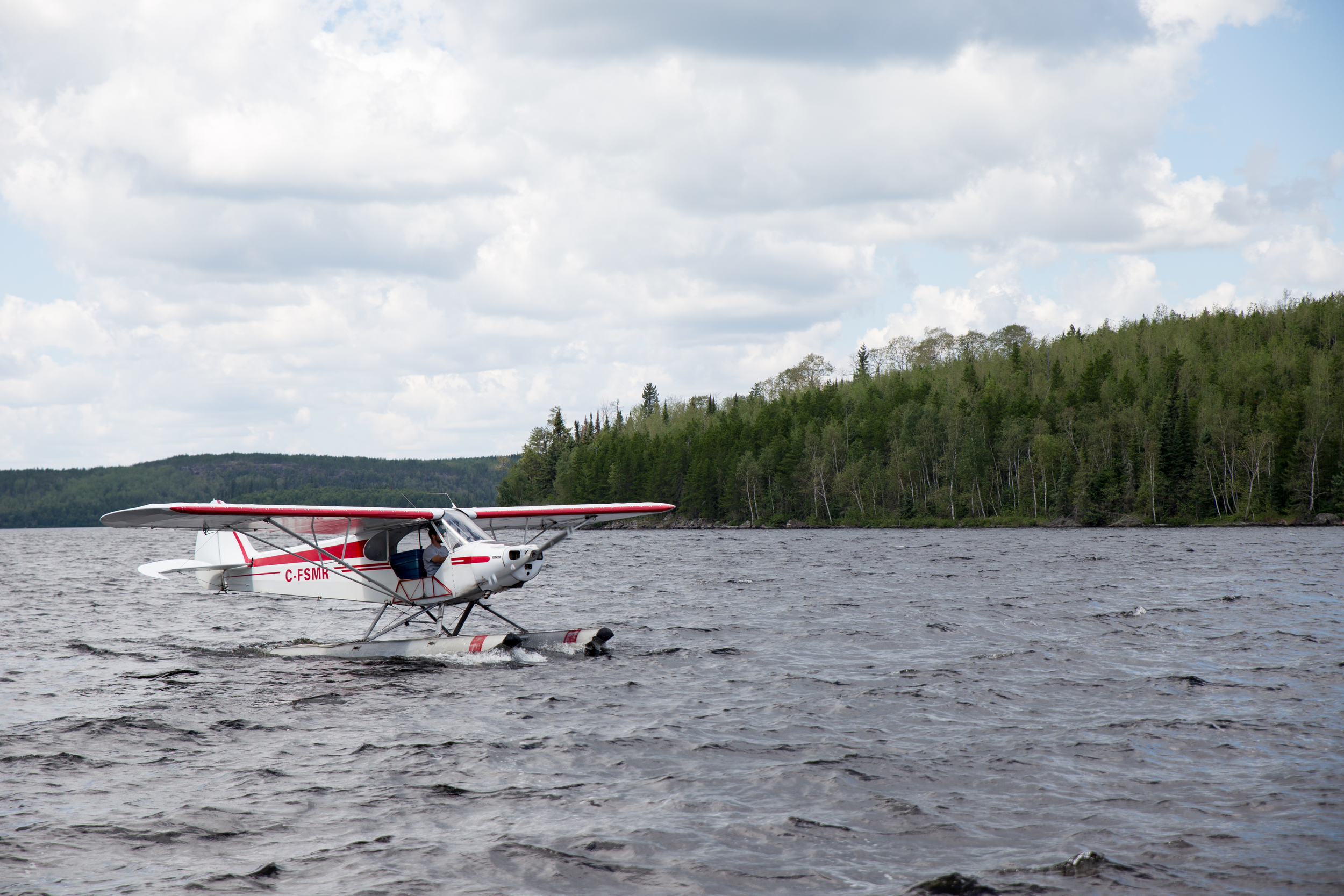 How the lodge gets bait. The pilot lands his plane in a stream, catches minnows and then delivers them to the remote lodges by landing on their lakes.