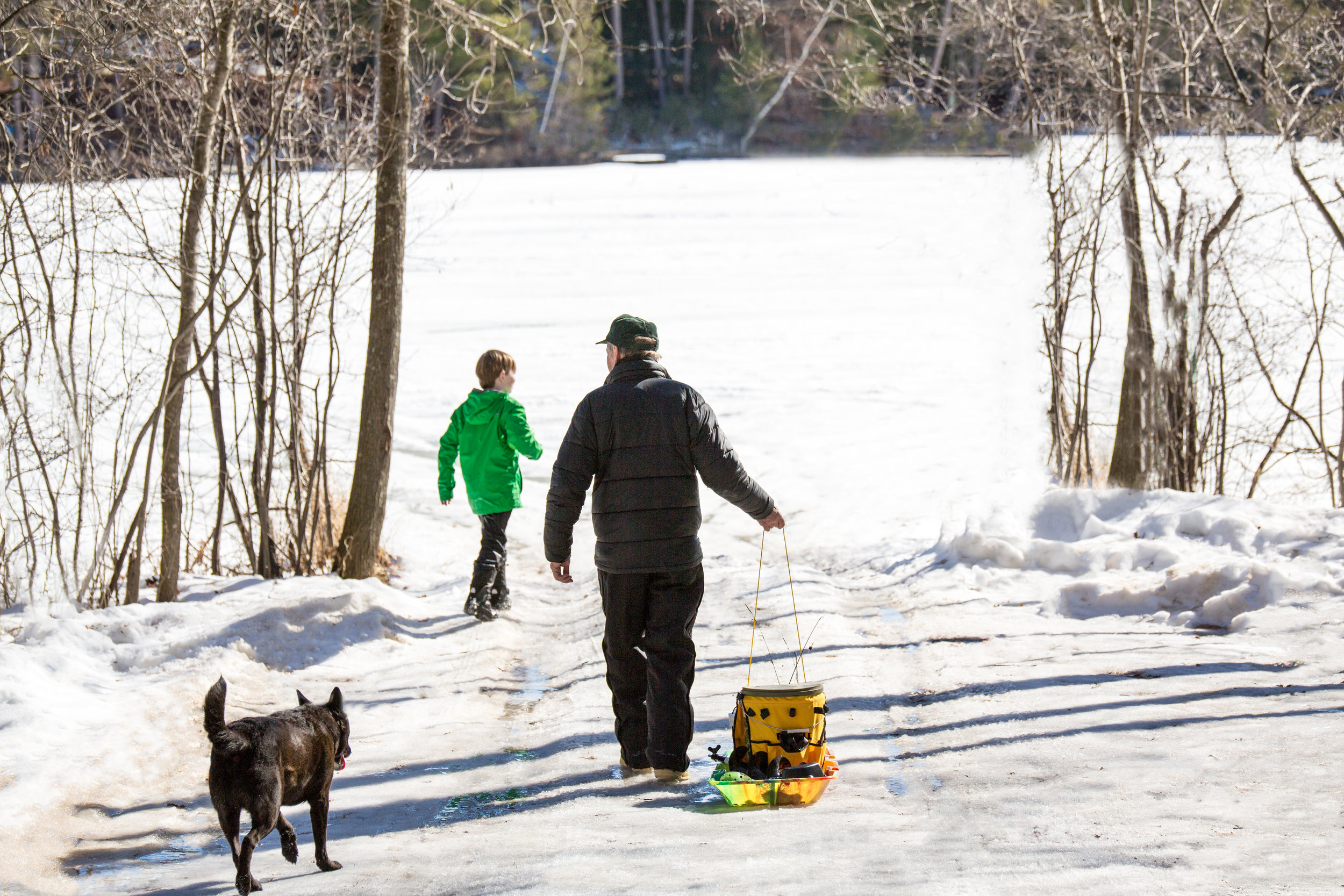 The ice-fishermen walking out to their spot on the lake
