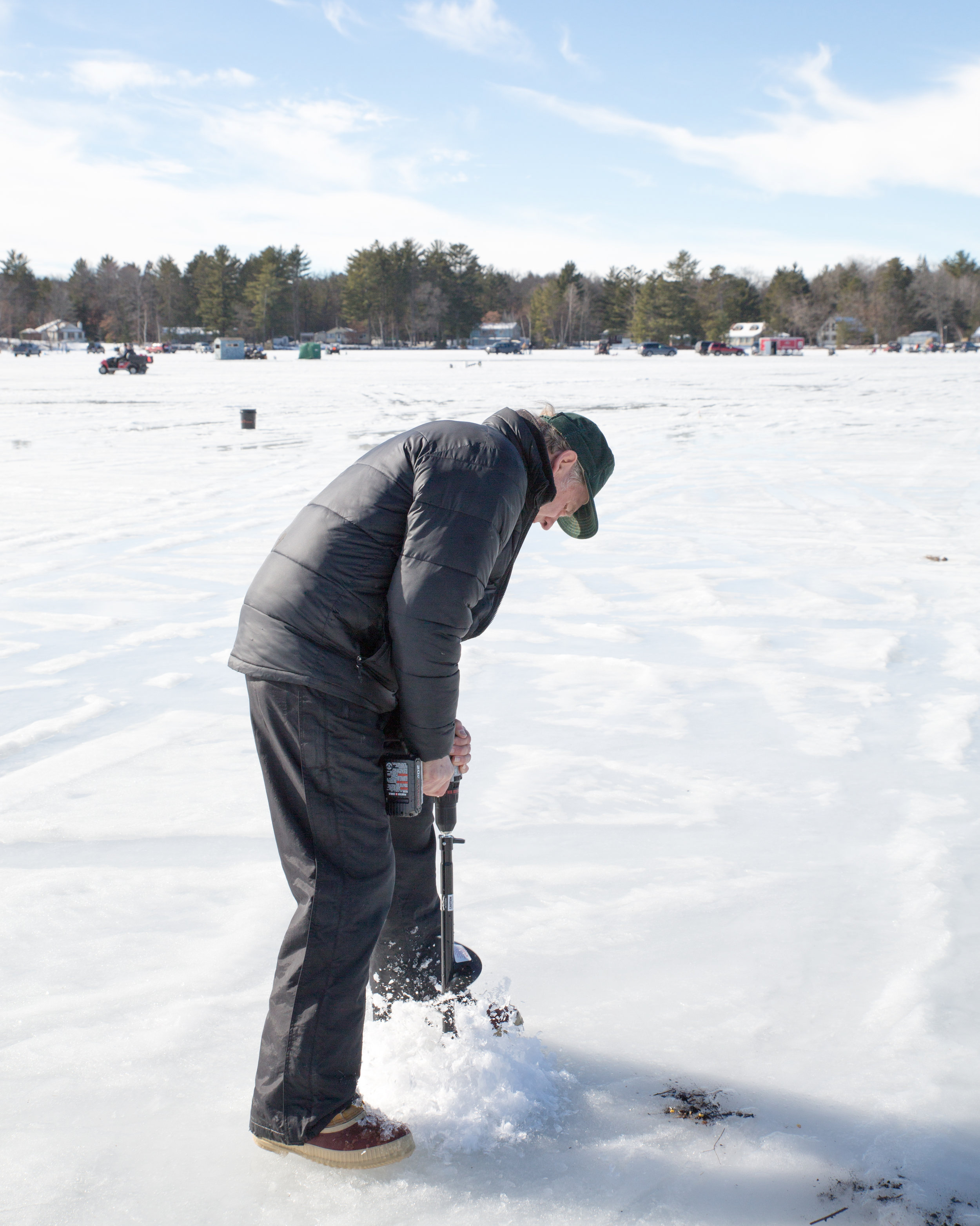 First: Grandpa drilled the hole through the ice with a cool attachment to his drill.