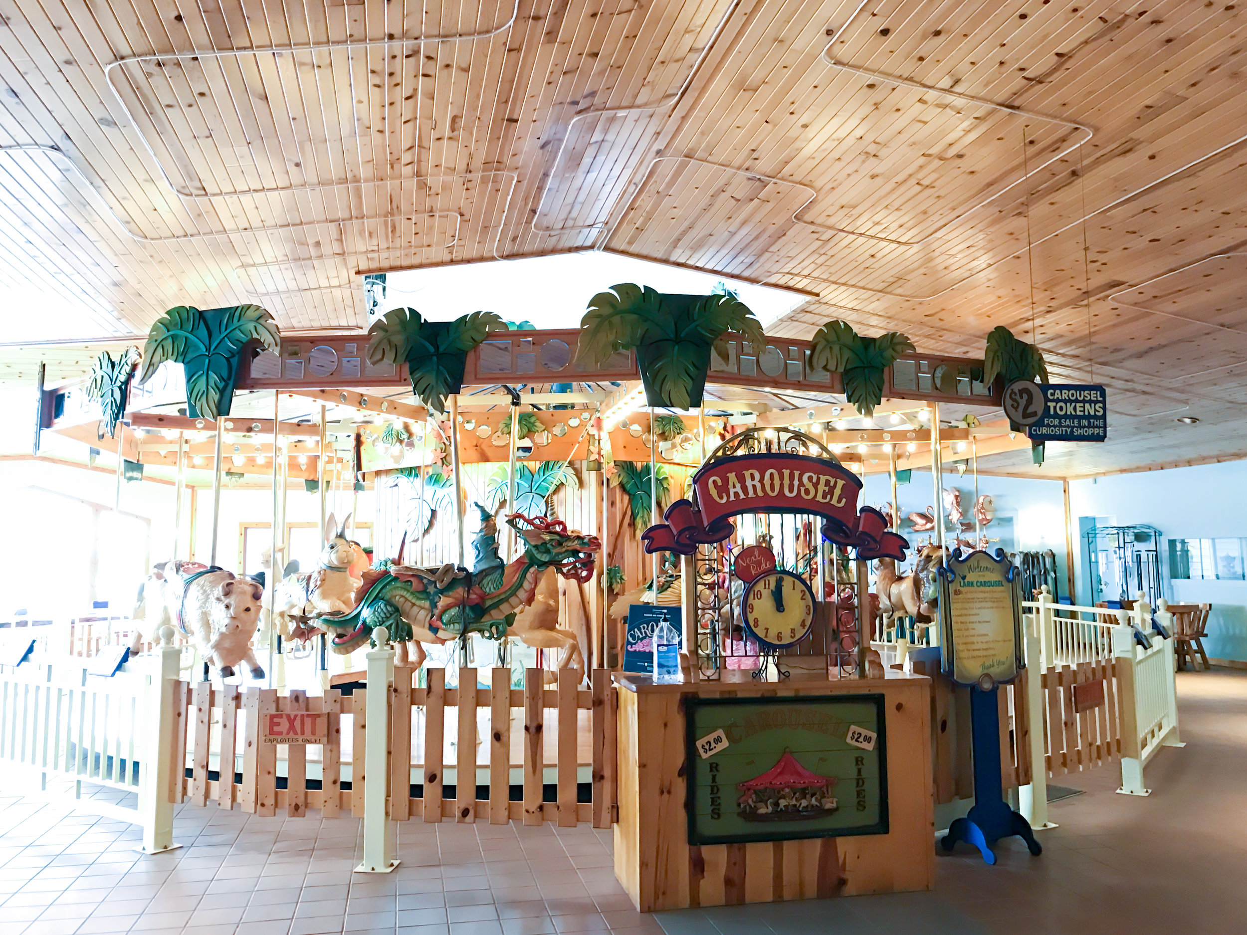 the most beautiful indoor carousel with hand carved, hand painted wooden animals at Lark Toys!