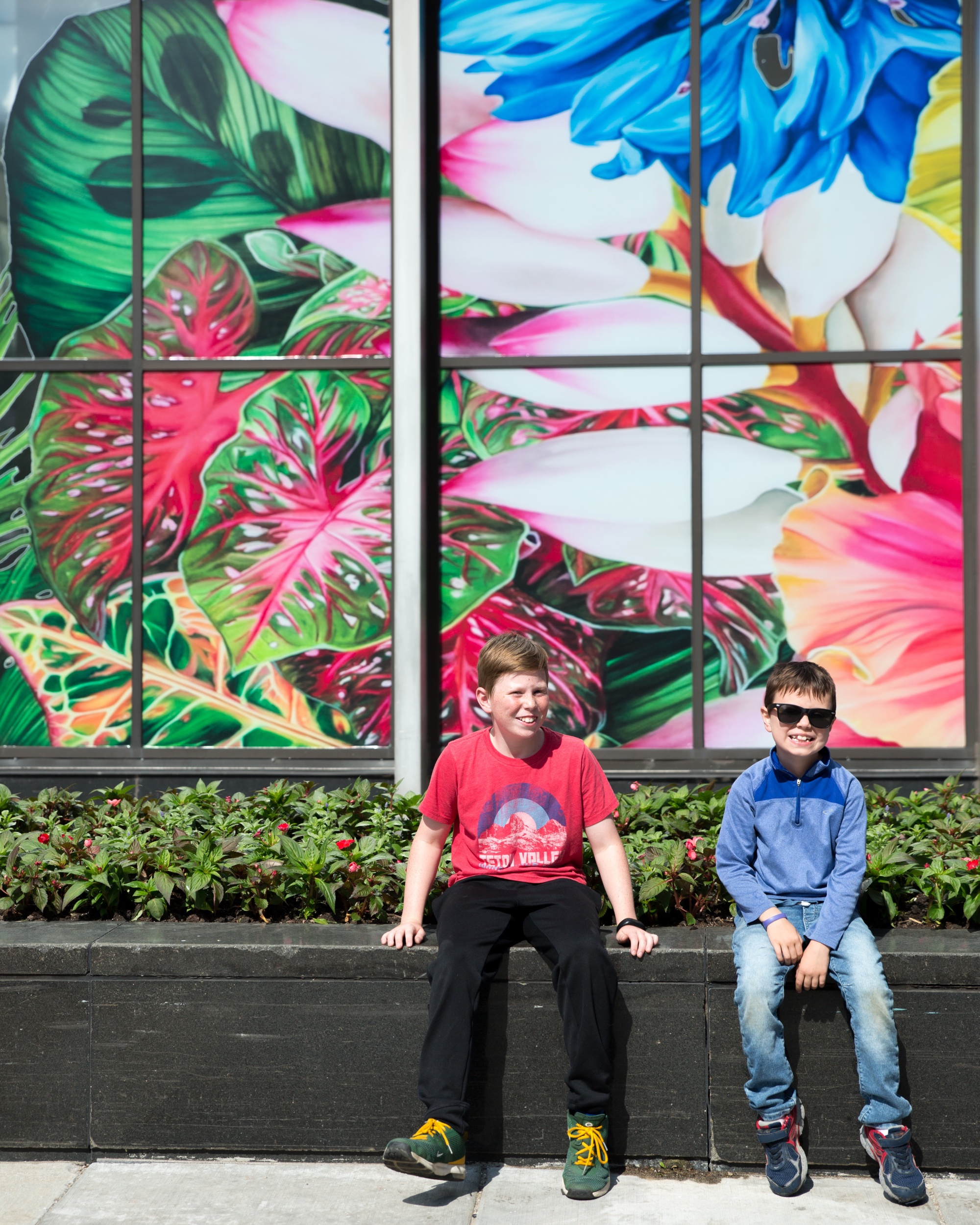 "Cute boys in front of ""Gild the Lily"" by Carlos Rolón"