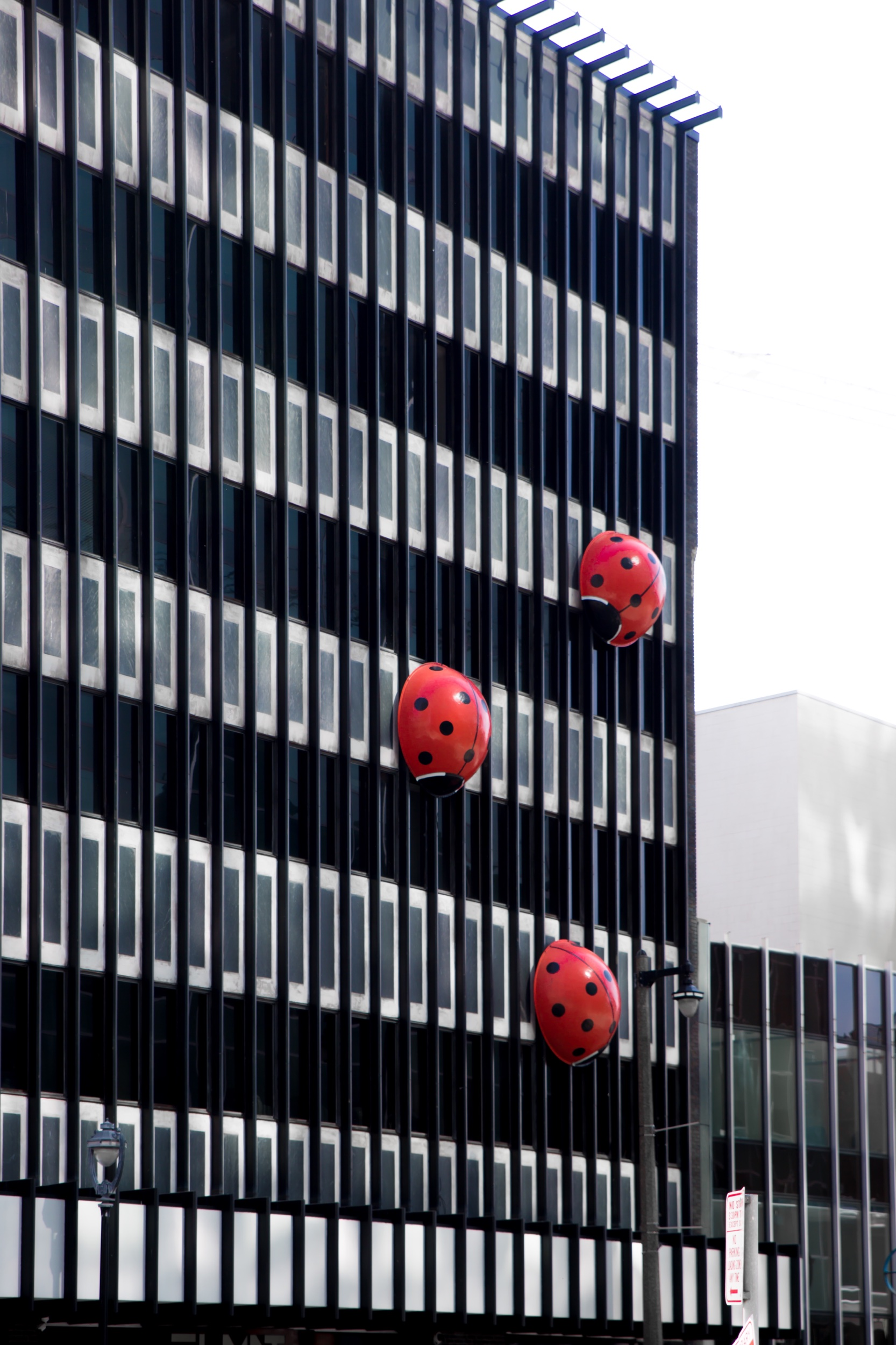 These little lady bugs climbing along this building have always been one of my favorites to visit in Milwaukee. They're not a part of the official Sculpture Milwaukee but you will see them on your walk! They've been there for almost 20 years! Each bug is about 6 feet tall. They were created by a sign maker who was hired by the building's owner, John Burke.