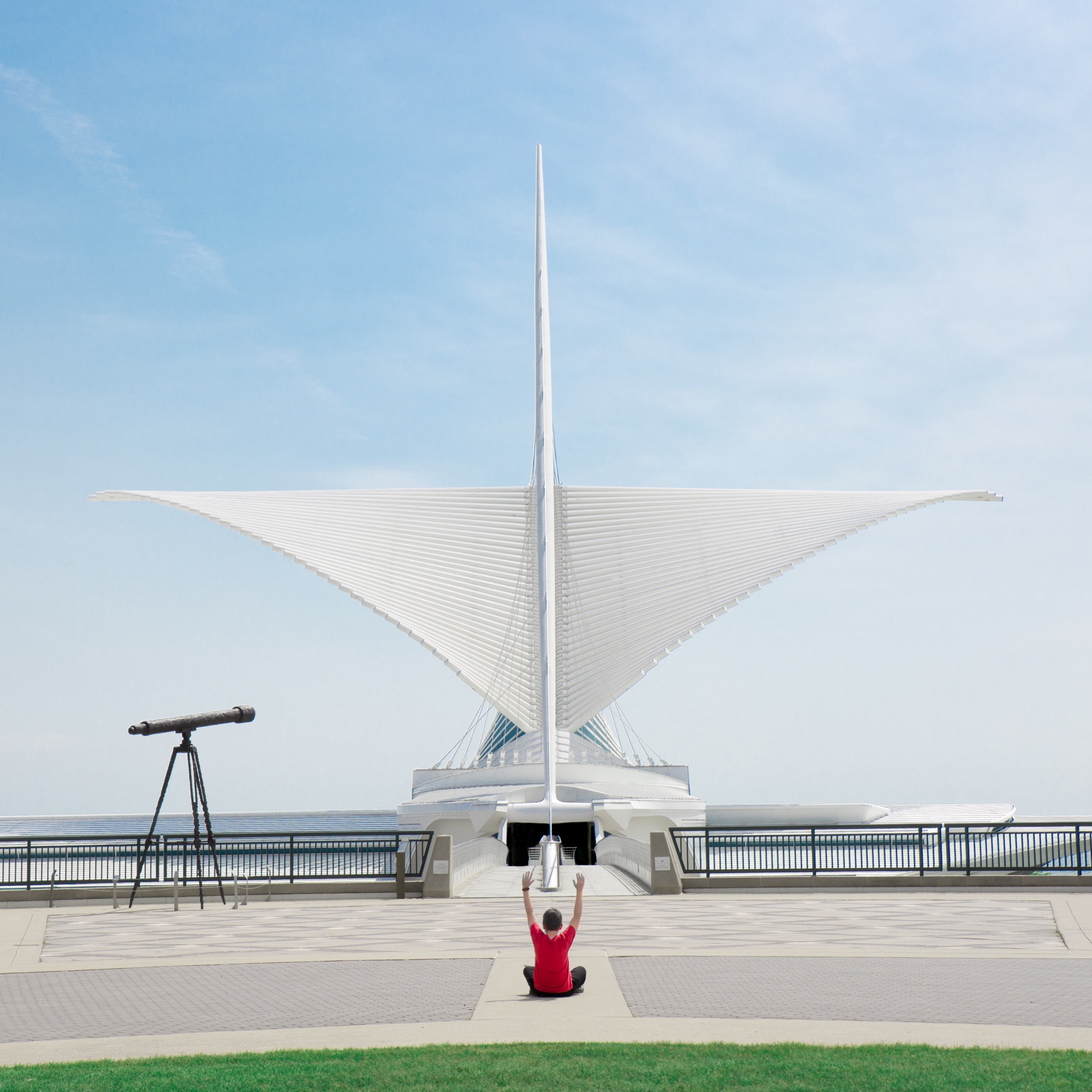 """Milwaukee Art Museum with """"A Greater Perspective"""" by Elmsgreen/Dragset on the left. The museum was holding a yoga class indoors so we did a little of our own outdoors."""