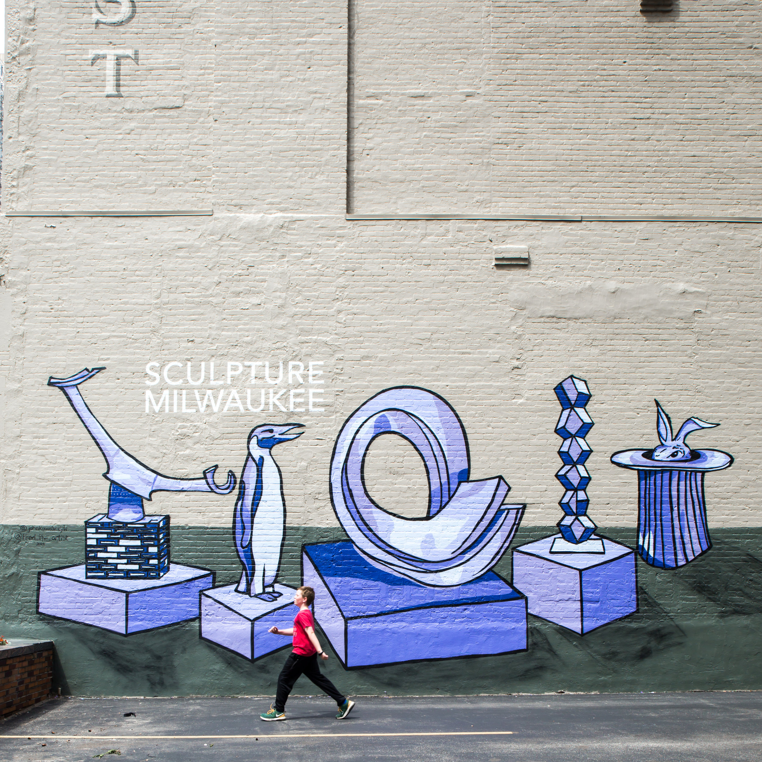 """Striding by the """"Sculpture Milwaukee"""" Mural by John Kowalczyk and Fred The Artists"""