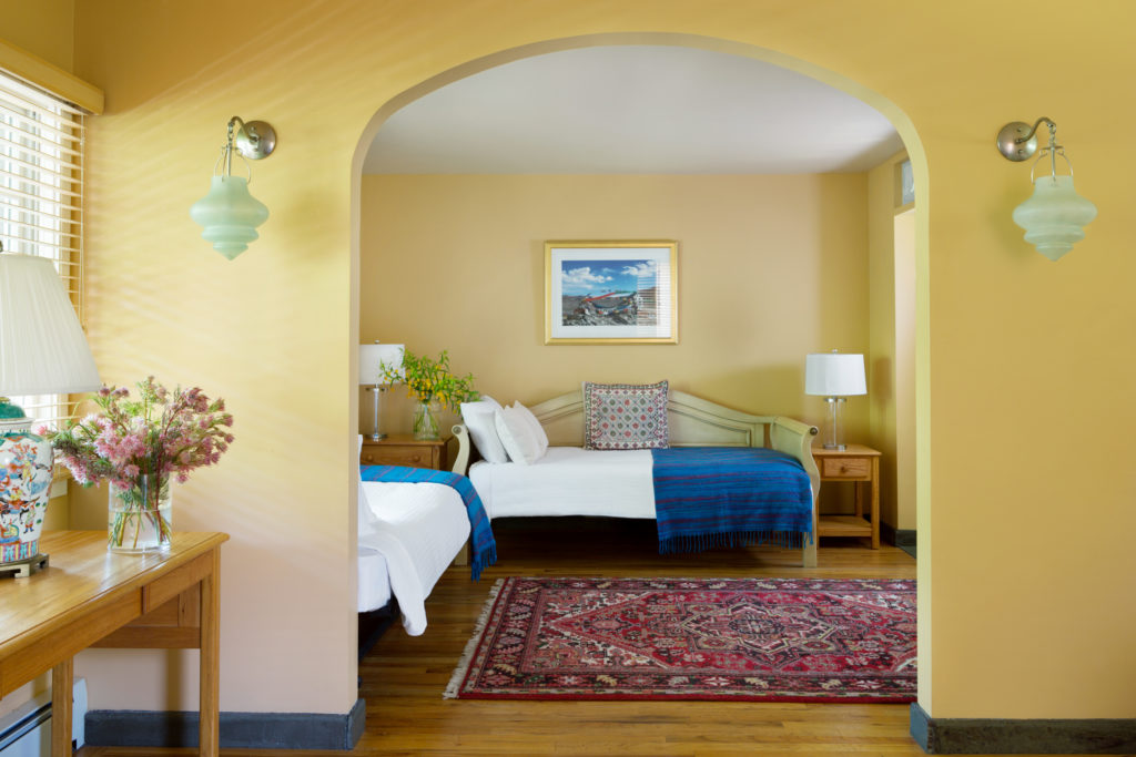 PACKAGE 5 - DELUXE QUAD w/PRIVATE BATH Features: Deluxe Quad Room, Four Twin Beds, Shared Bath, Hi Speed Wi-Fi Internet