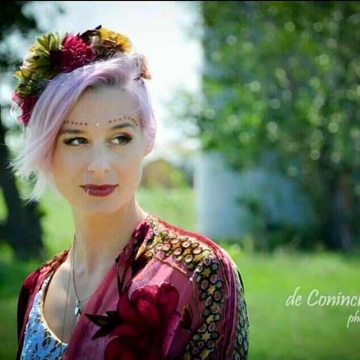 Stunning Bride Britta on her wedding day Wearing The House Of Hats custom made silk flower headpiece