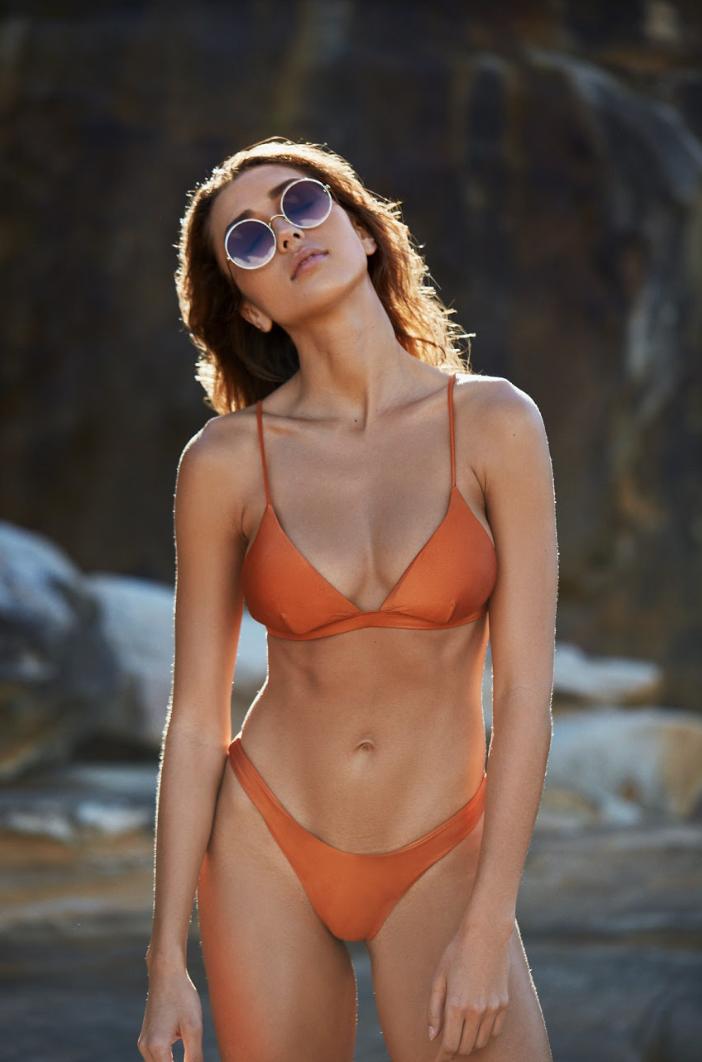 Shannon Lawson wears I AM ZAZIE Harper Tri Bikini Top & Yvie Cheeky Bikini Pant in luxe Italian Lycra - SHOP THE LOOK HERE >
