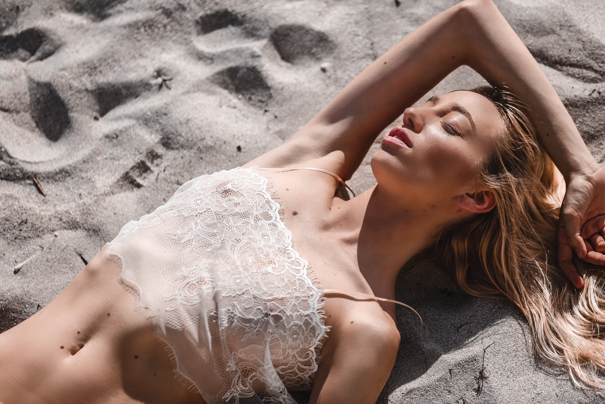 Macy Mariano wears I AM ZAZIE's Après Swim sheer  Aurora Chantilly Lace Crop Top  in White. Photographed by Drea Off Duty in Miami, Florida.