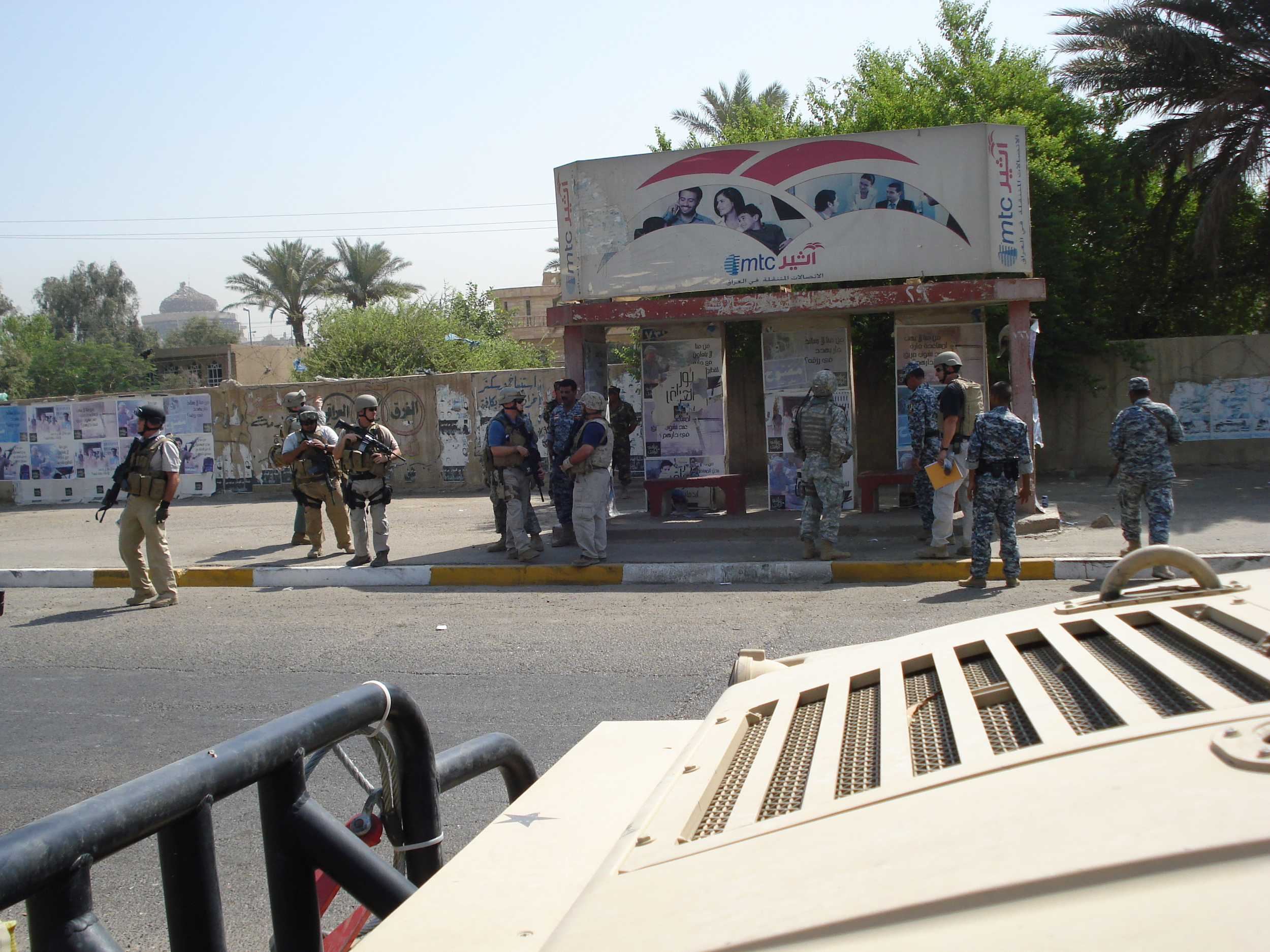 Notice how the American investigators are accompanied by the Iraqis.