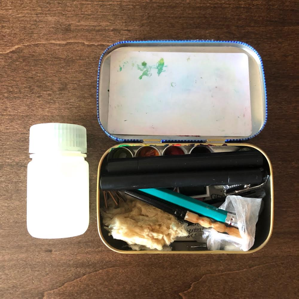 This tin is very similar to the Altoids tin except it is just a tad taller which allows for stacking brushes on top of the paint.