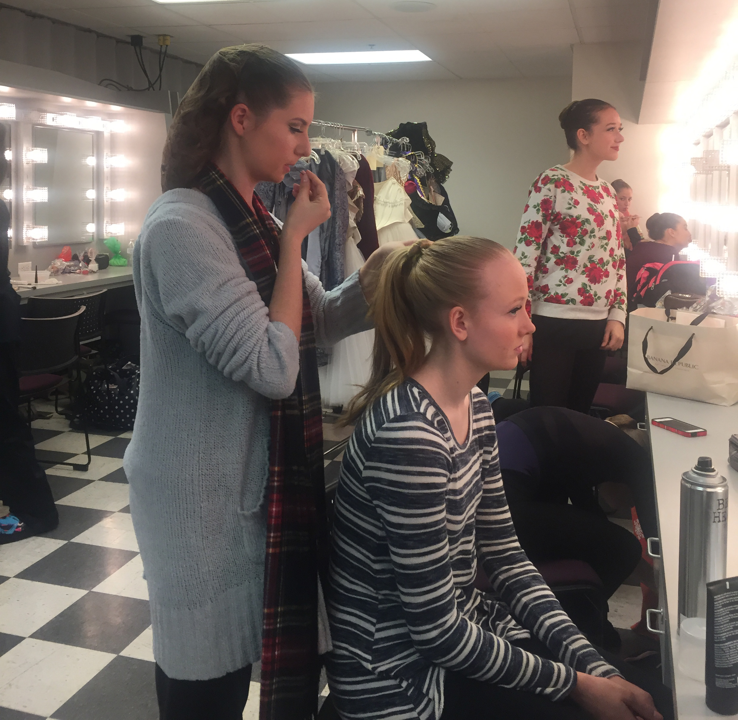 Like mother like daughter, Brooke helping her fellow dancers with their pre-show hair & makeup needs.