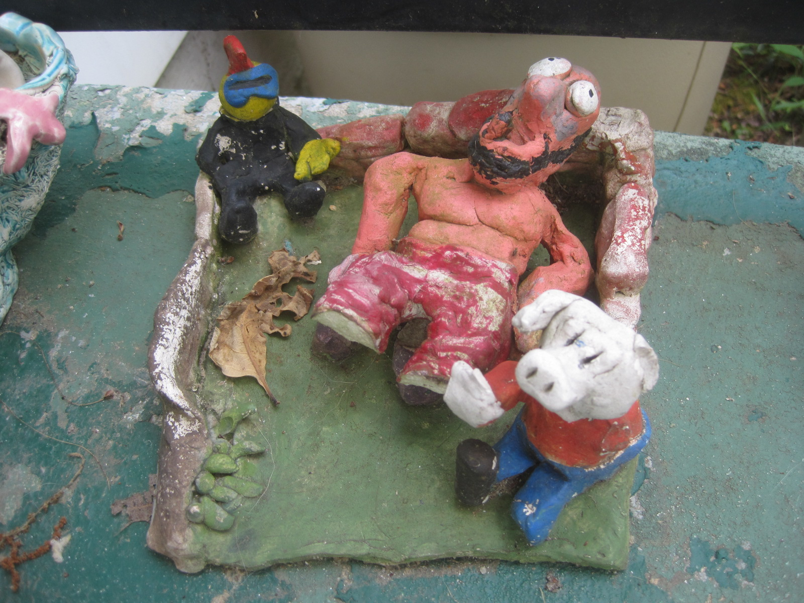 Another very early sculpture. This one used to have a duck sitting on the back wall. The man needs to be glued upright and the pig has lost an arm, but I think it shows some indication of the direction I took with art.